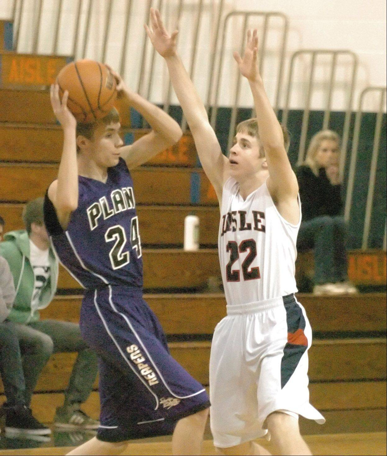 Craig Thom of Plano looks to pass over Connor Bielat of Lisle.