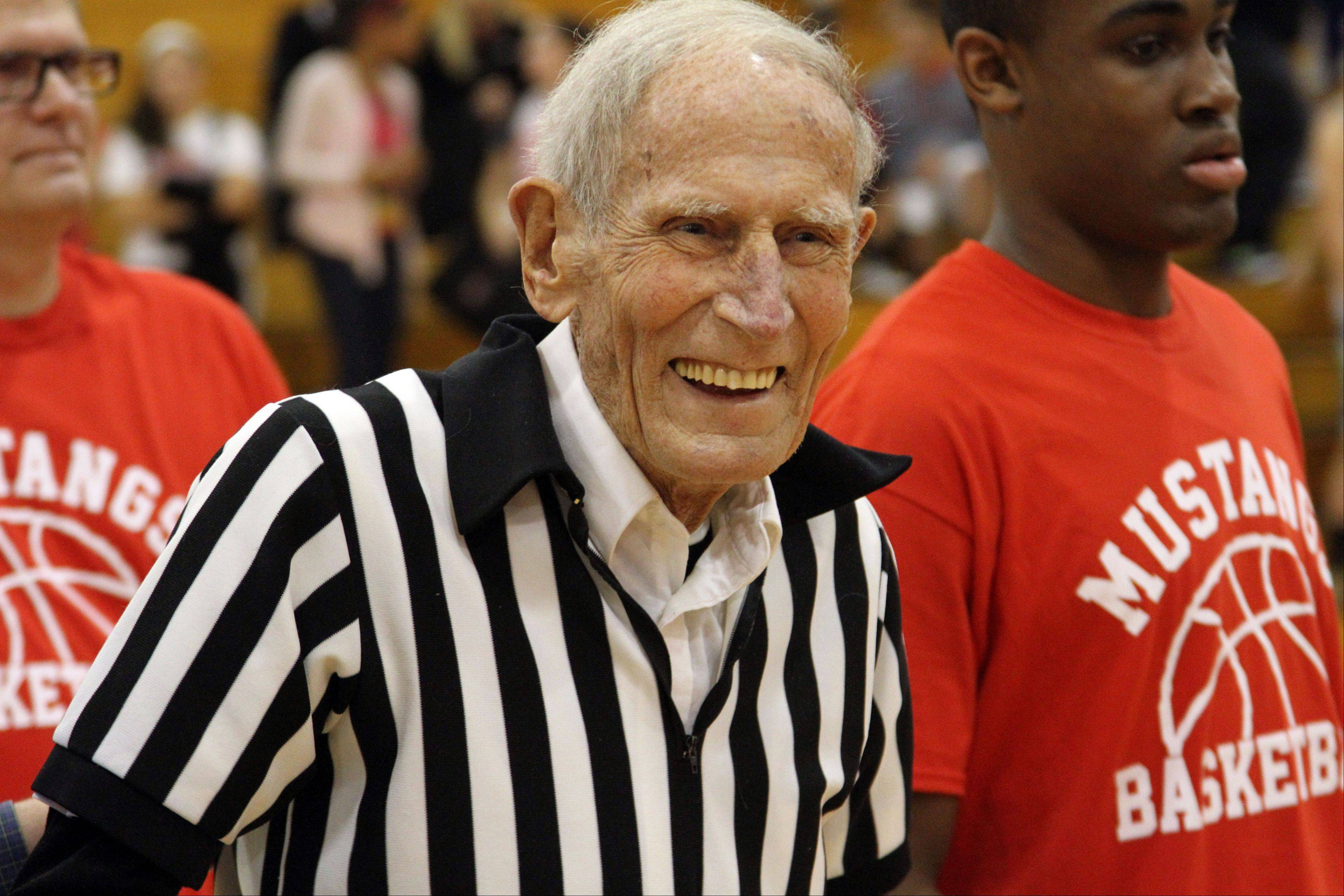 Mundelein basketball scorekeeper Jim Ackley is all smiles after being honored for 50 years of service before Tuesday night's varsity boys basketball game against Lake Zurich.