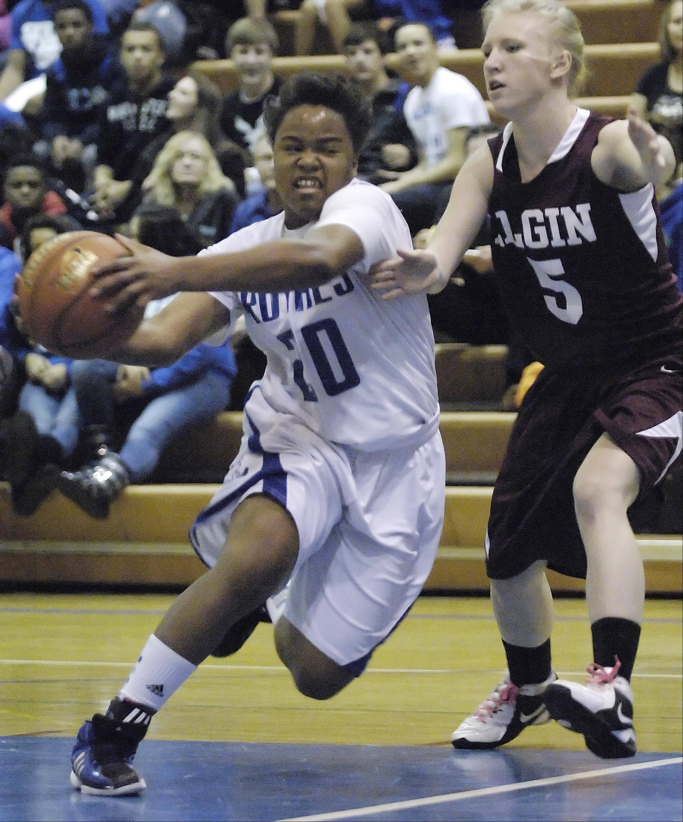 Larkin's Quixmia Washington drives around Elgin's Melanie Berg .