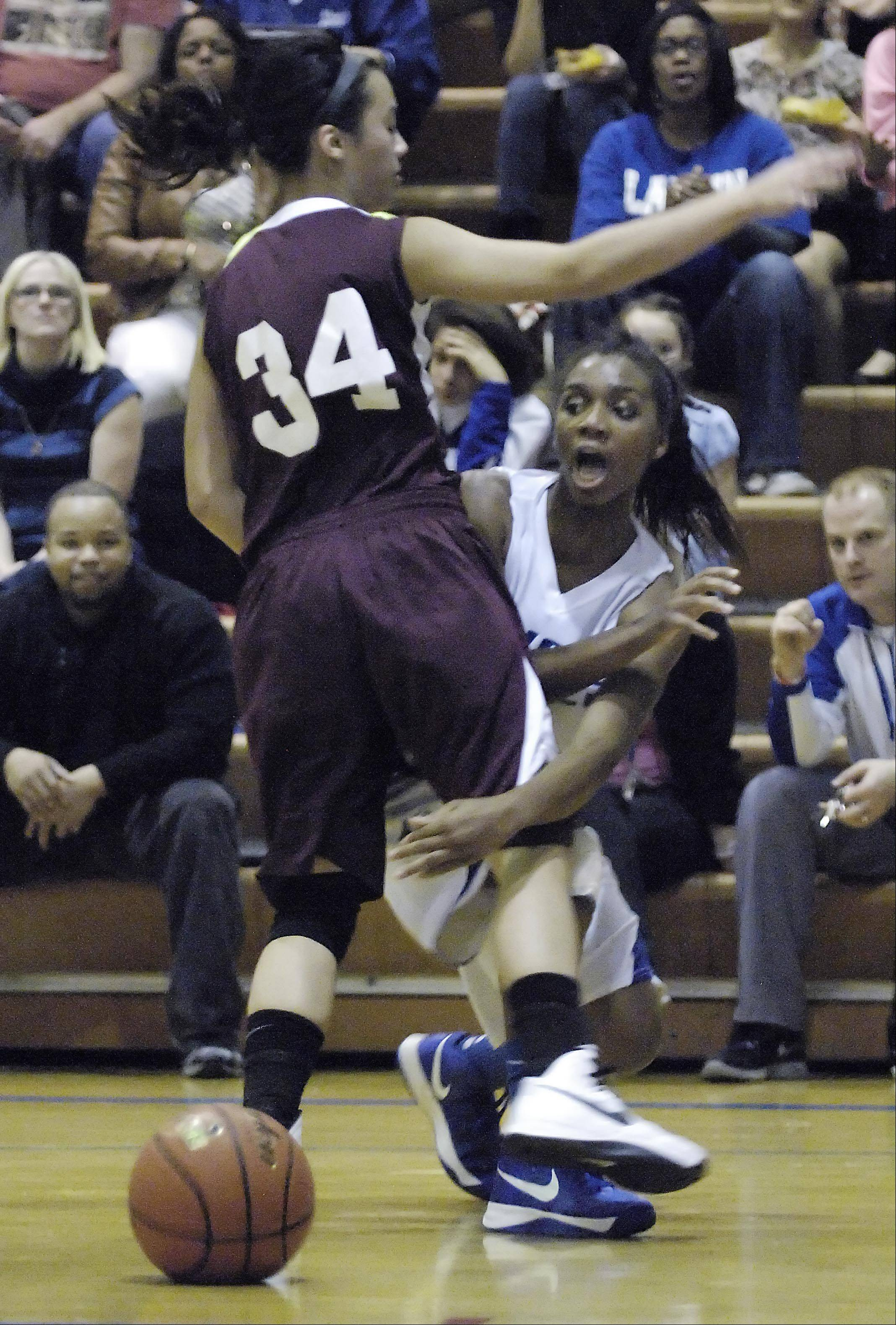 Larkin's Taylor Chandler-Lindsey passes the ball around Elgin's Kristin Tayag.