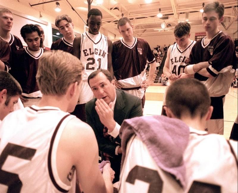 former elgin high boys basketball coach jim harrington above speaking to his 1997 98