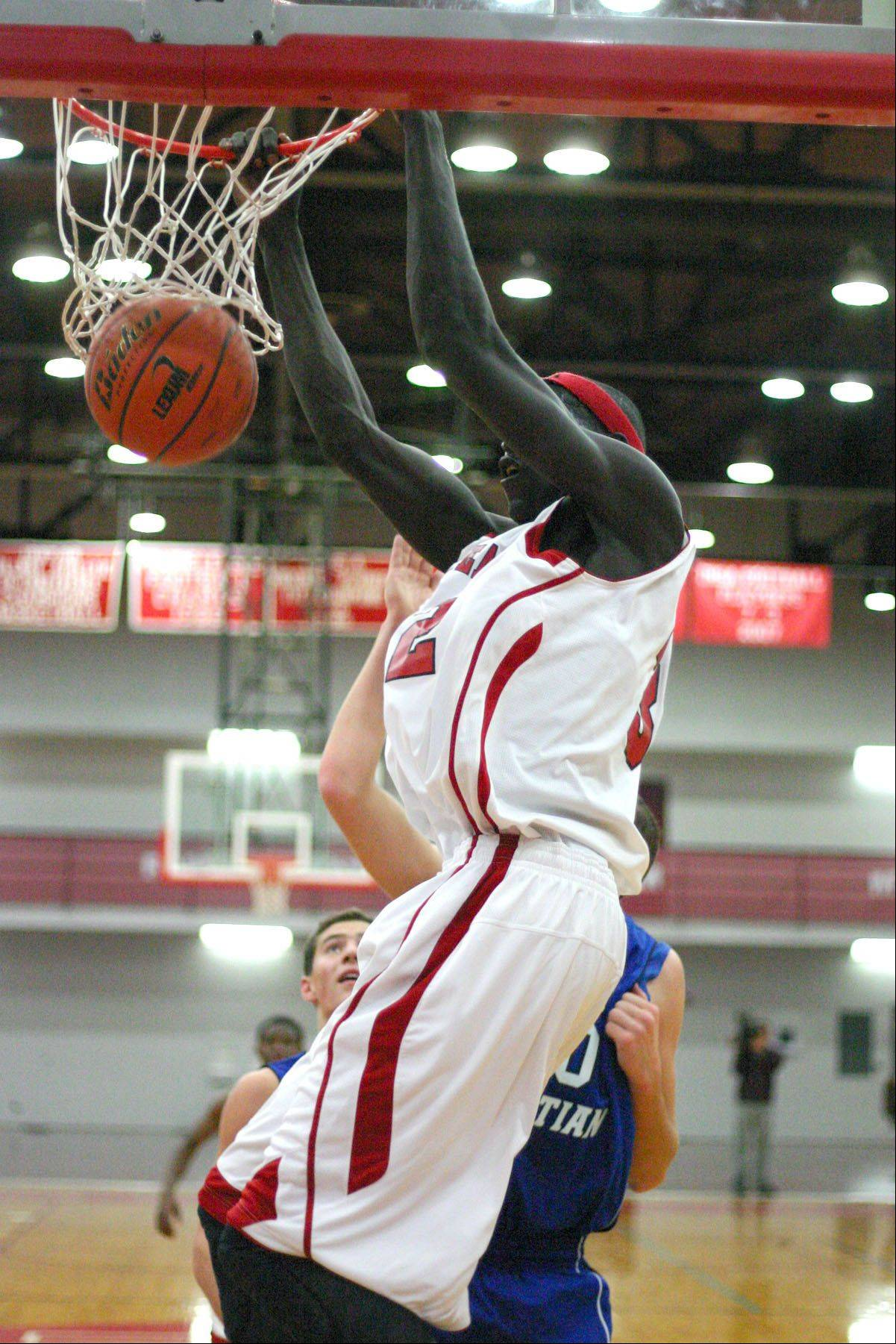 COURTESY OF MOOSEHEART Mooseheart junor Makur Puou dunks in Tuesday's 53-21 victory over Westminster Christian. Puou scored a game-high 16 points in the victory.