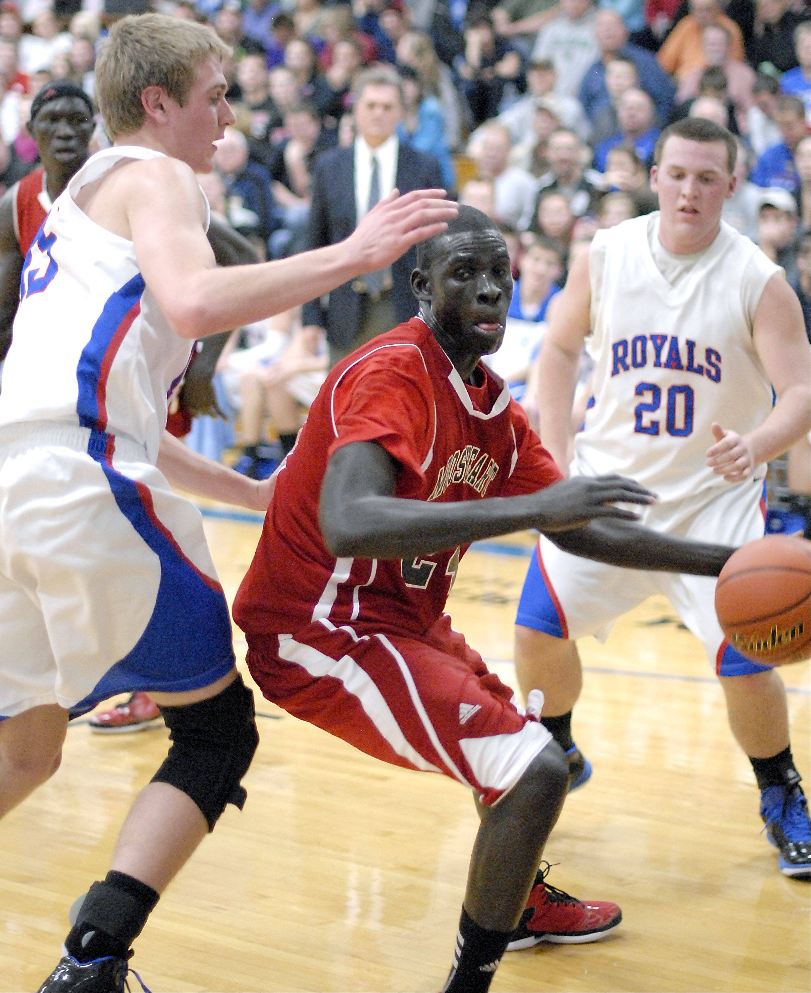Mooseheart's Mangisto Deng maneuvers around Hinckley-Big Rock's Nick Gentry.