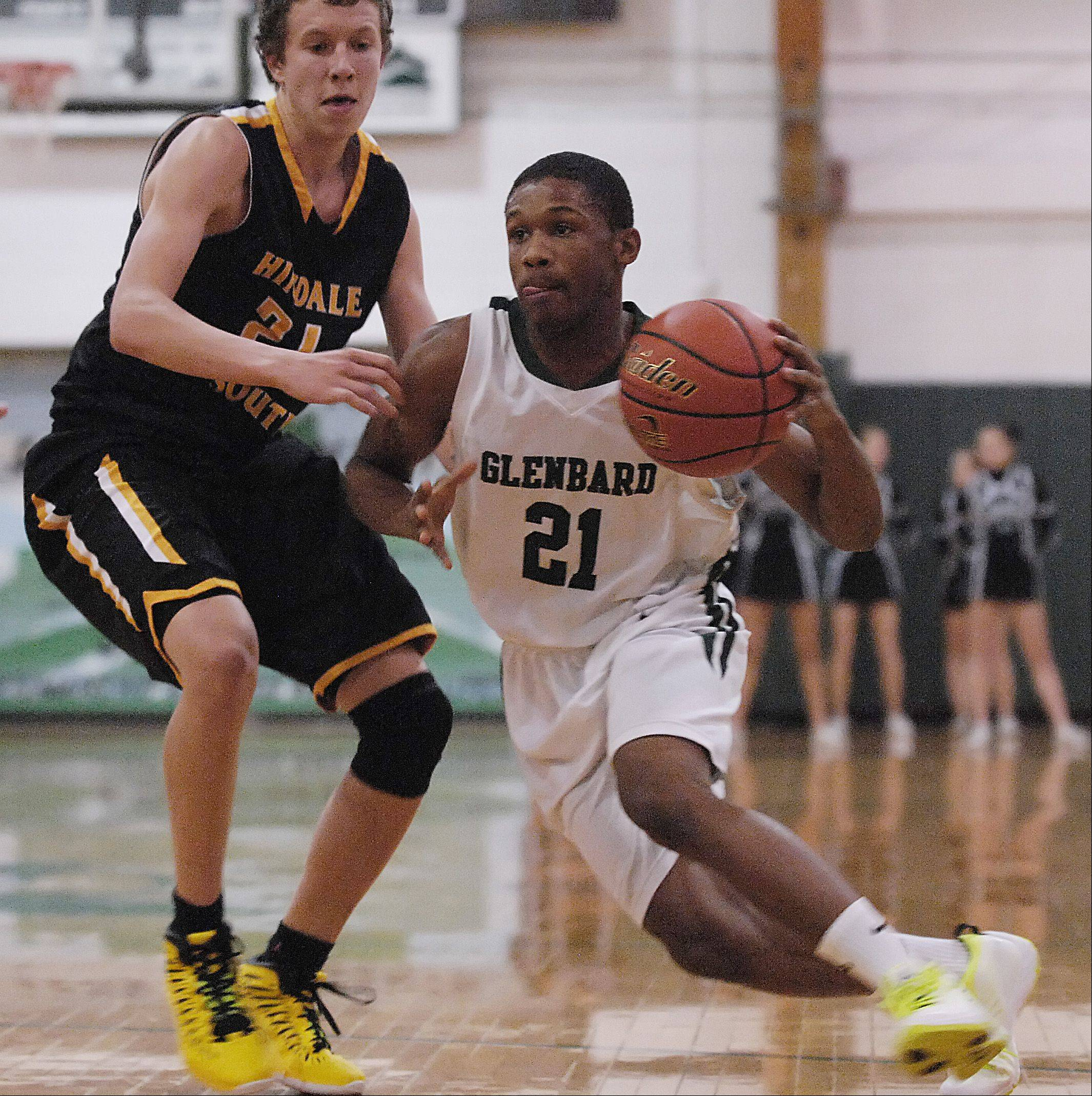Dikiria Washington of Glenbard West drives around Larry Motuzis of Hinsdale South.