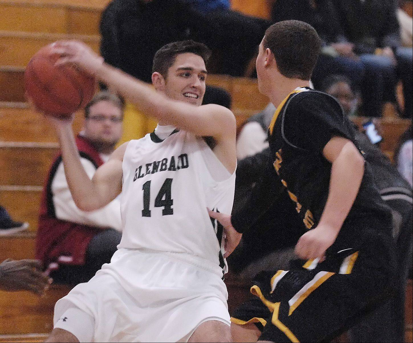 Ben Kane of Glenbard West High School looks to pass around Jerry Stoltz of Hinsdale South High School.