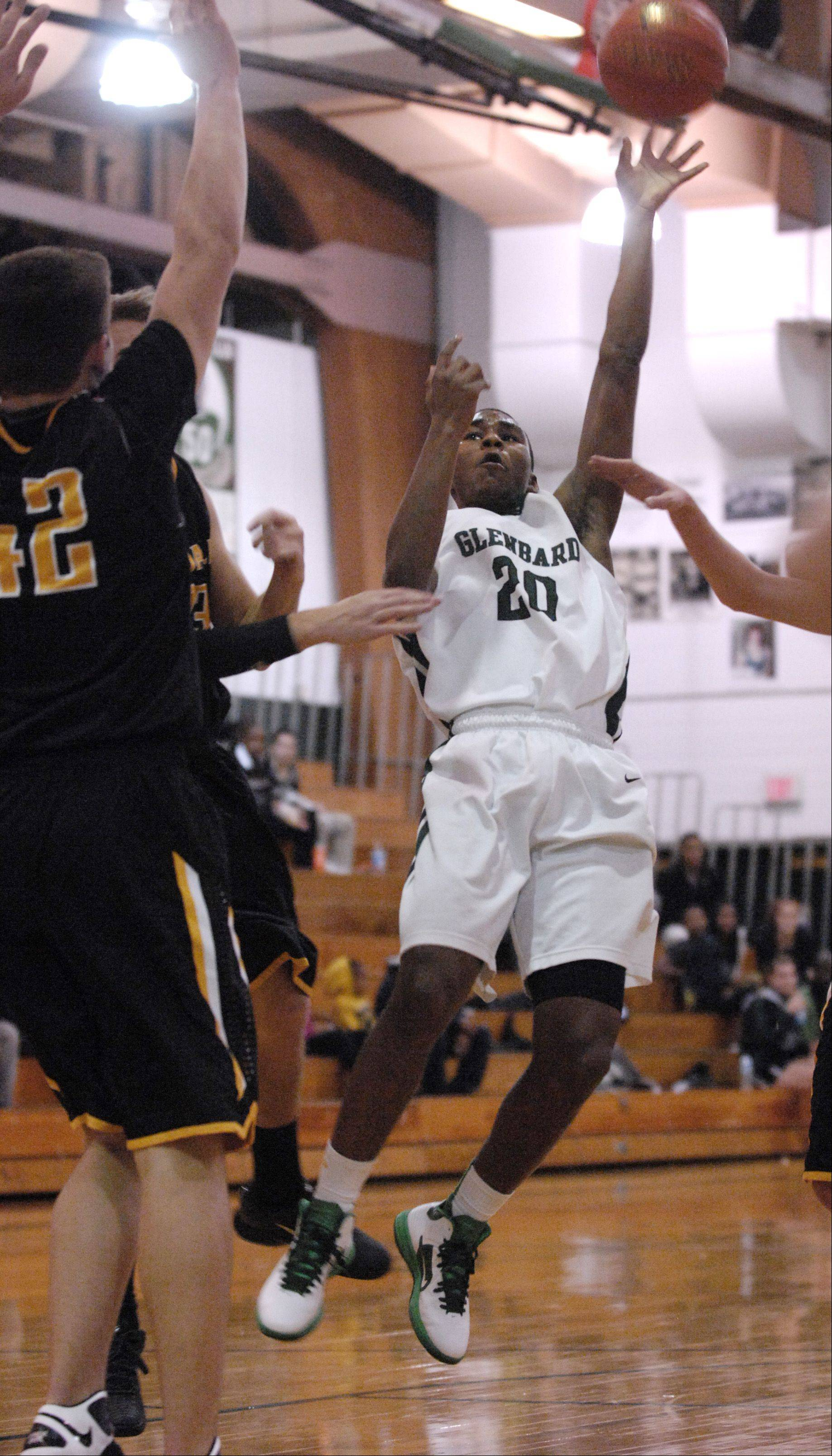 Corey Davis of Glenbard West takes a shot against Hinsdale South High School.