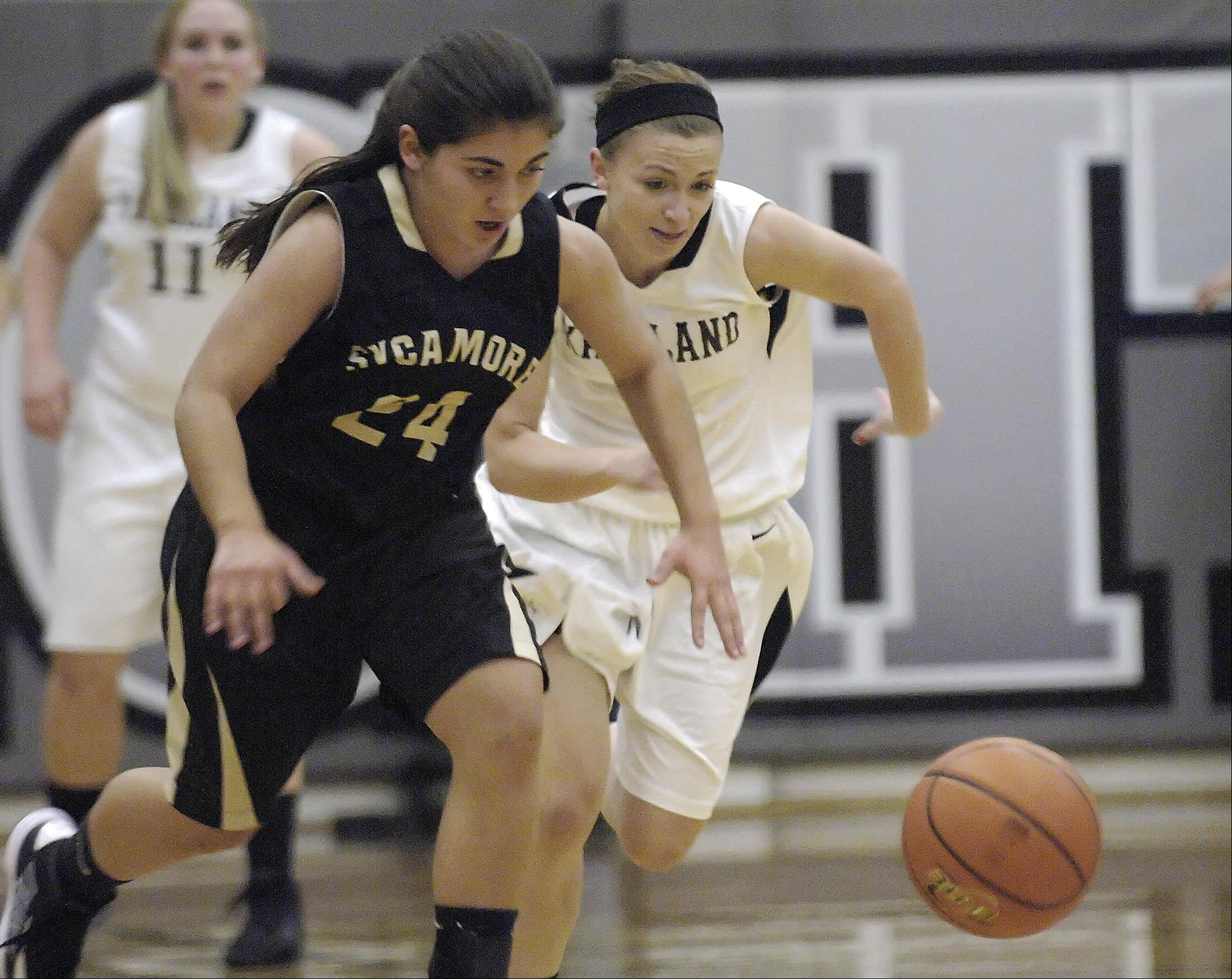 Kaneland's Caroline Heimerdinger and Sycamore's Julia Moll chase a loose ball that Heimerdinger poked away Thursday in Maple Park.