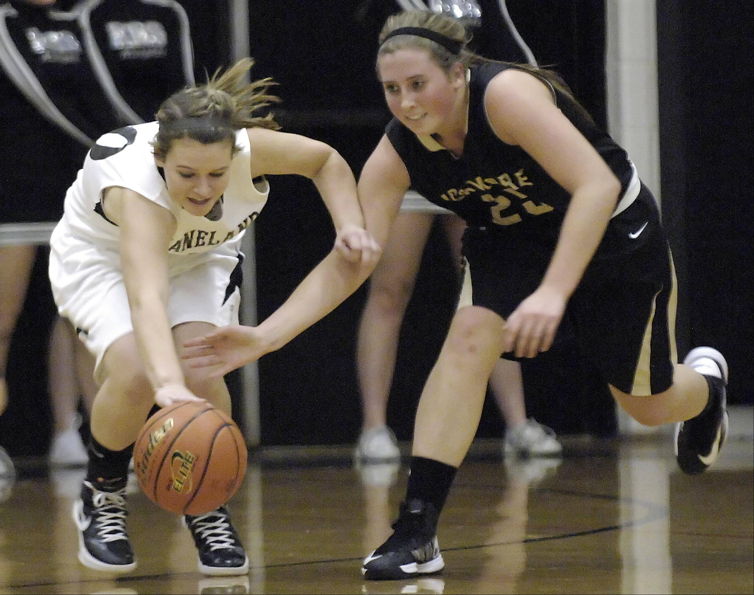 Kaneland's Allyson O'Herron gets to a loose ball before Sycamore's Bailey Gilbert Thursday in Maple Park.