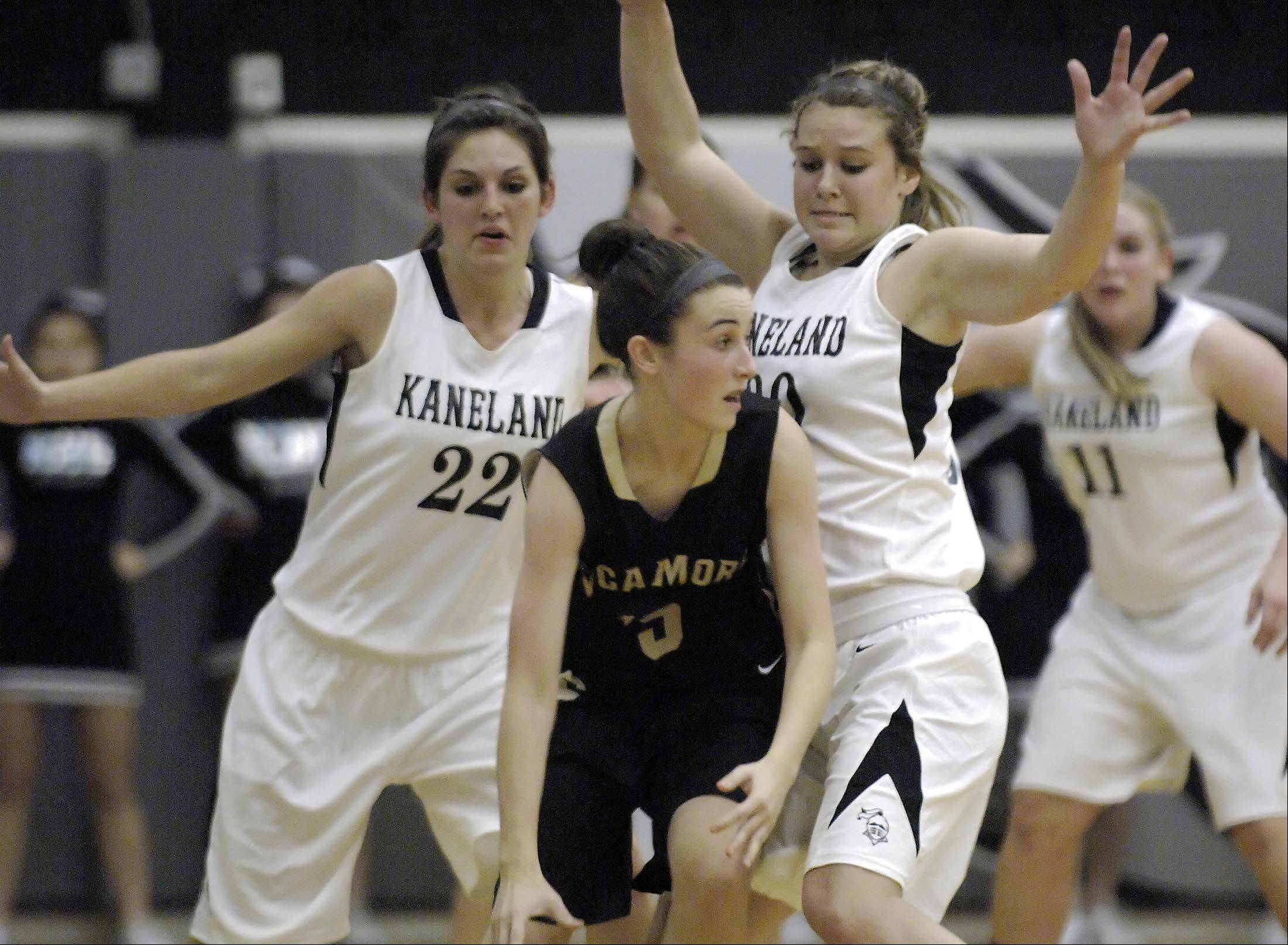 Kaneland's Brooke Harner and Ally VanBogaert, right, pressure Sycamore's Lauren Goff Thursday in Maple Park.