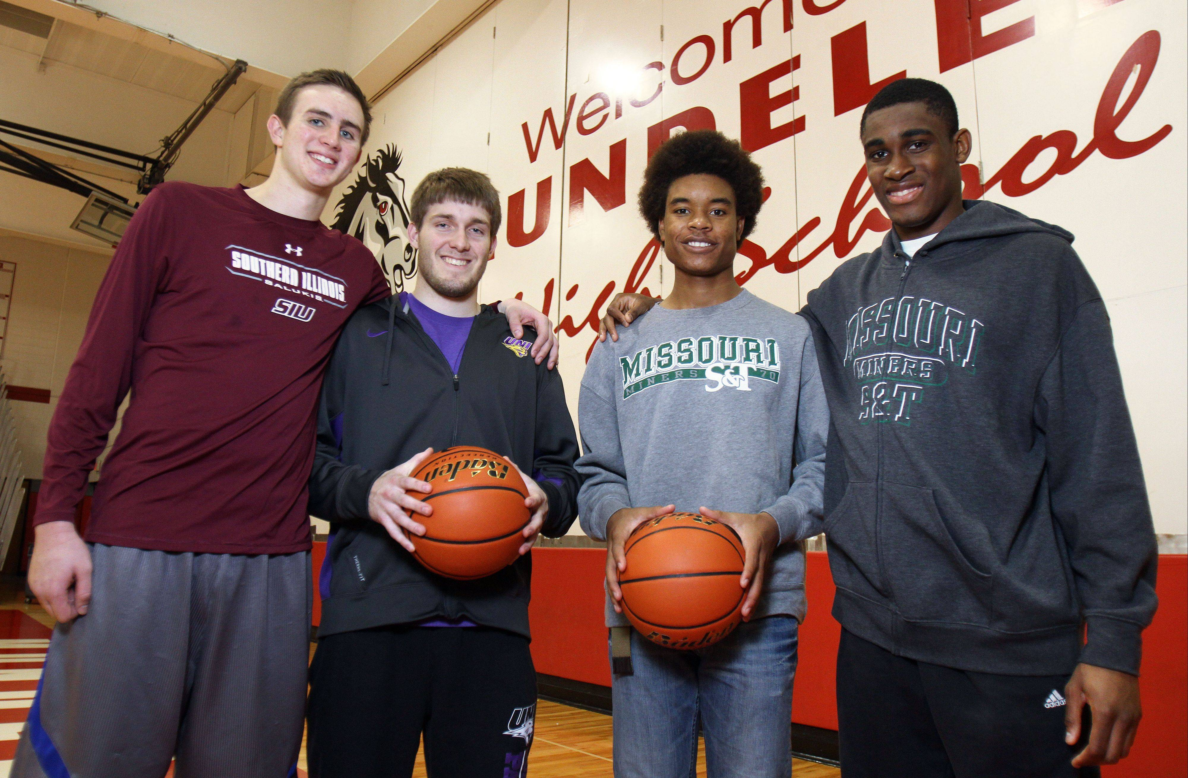 The Mundelein boys basketball team has four players headed for full college scholarships. From left are Sean O'Brien, Robert Knar, Cliff Dunigan and Chino Ebube.