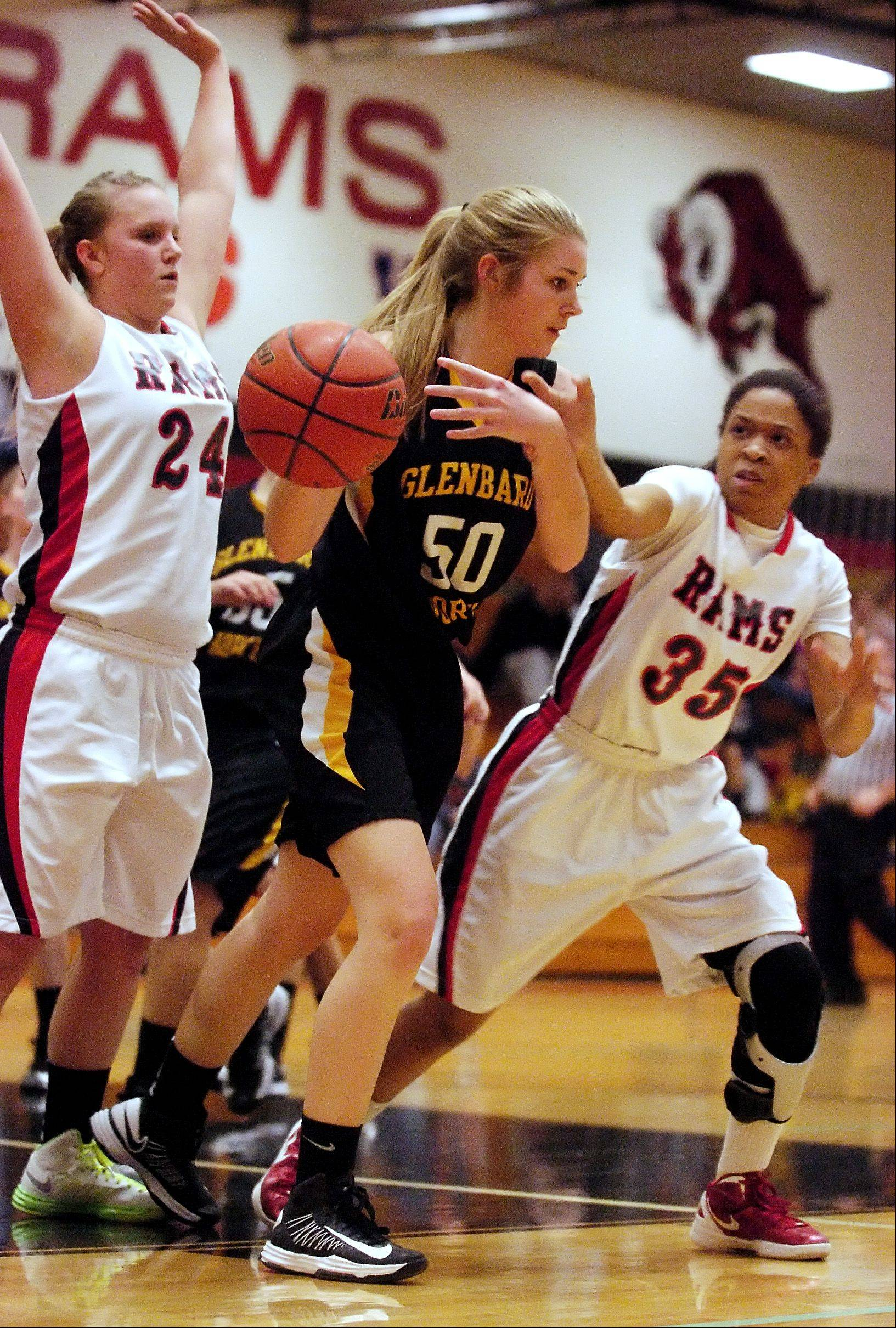 Caitlyn Deegan of Glenbard North works to get past Rachael Leifheit and Teaira Miller of Glenbard East.