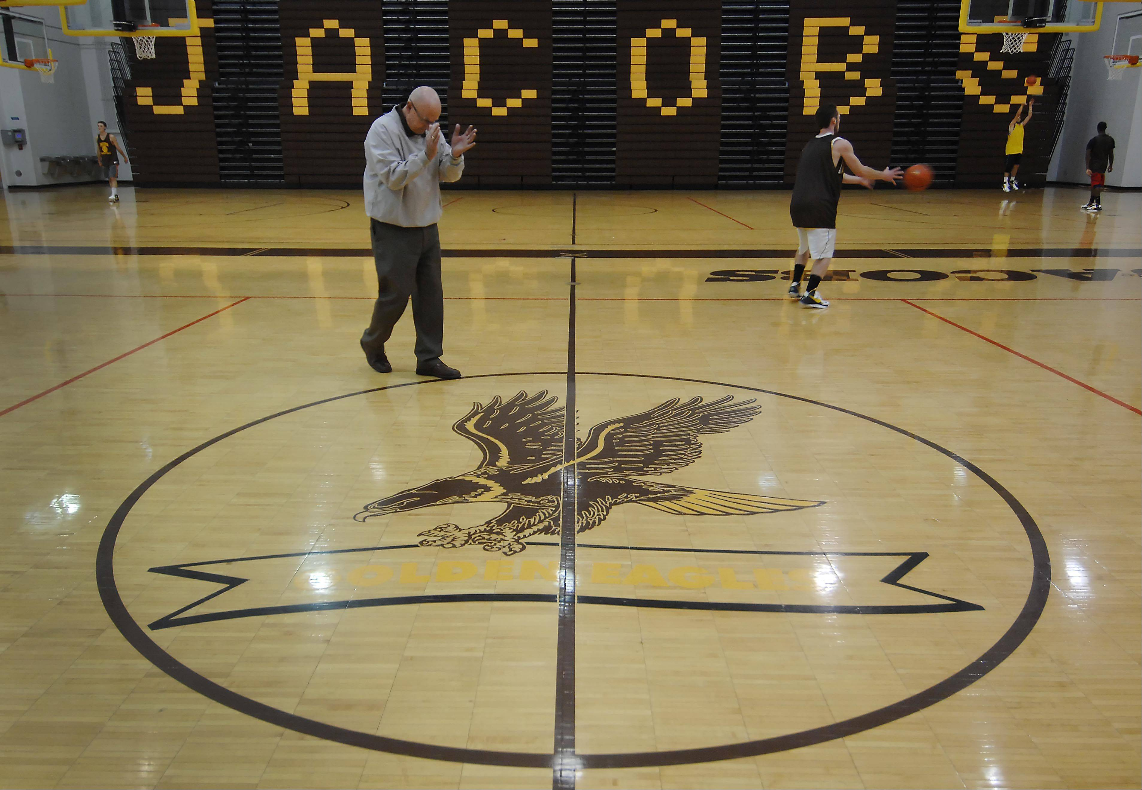 Coach Jim Hinkle has directed the Jacobs High School boys basketball team since 1996.