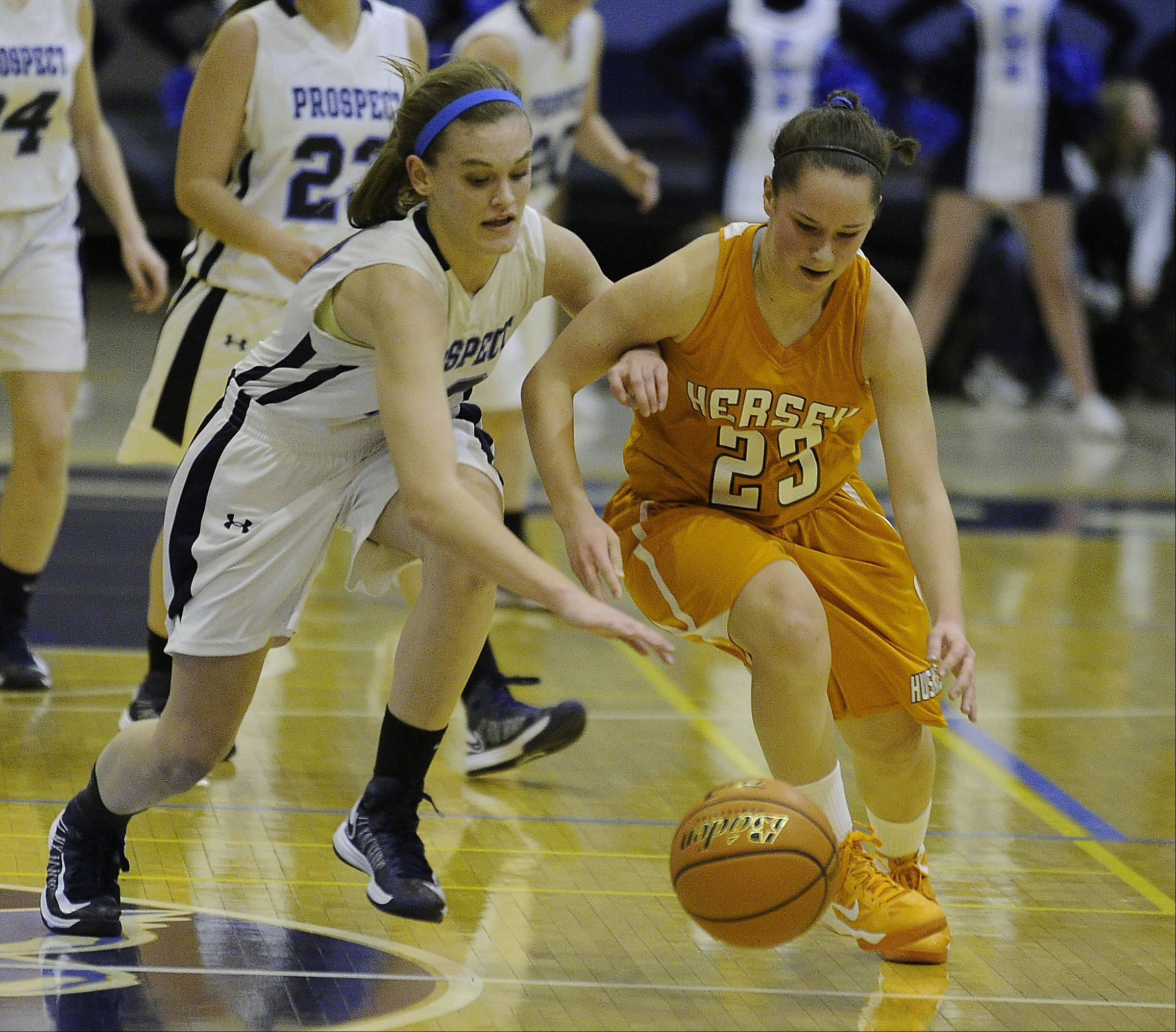 Prospect's Taylor Will chases down a loose ball with Hersey's Casey Weyhrich in the first half at the girls varsity game at Prospect High School on Friday.