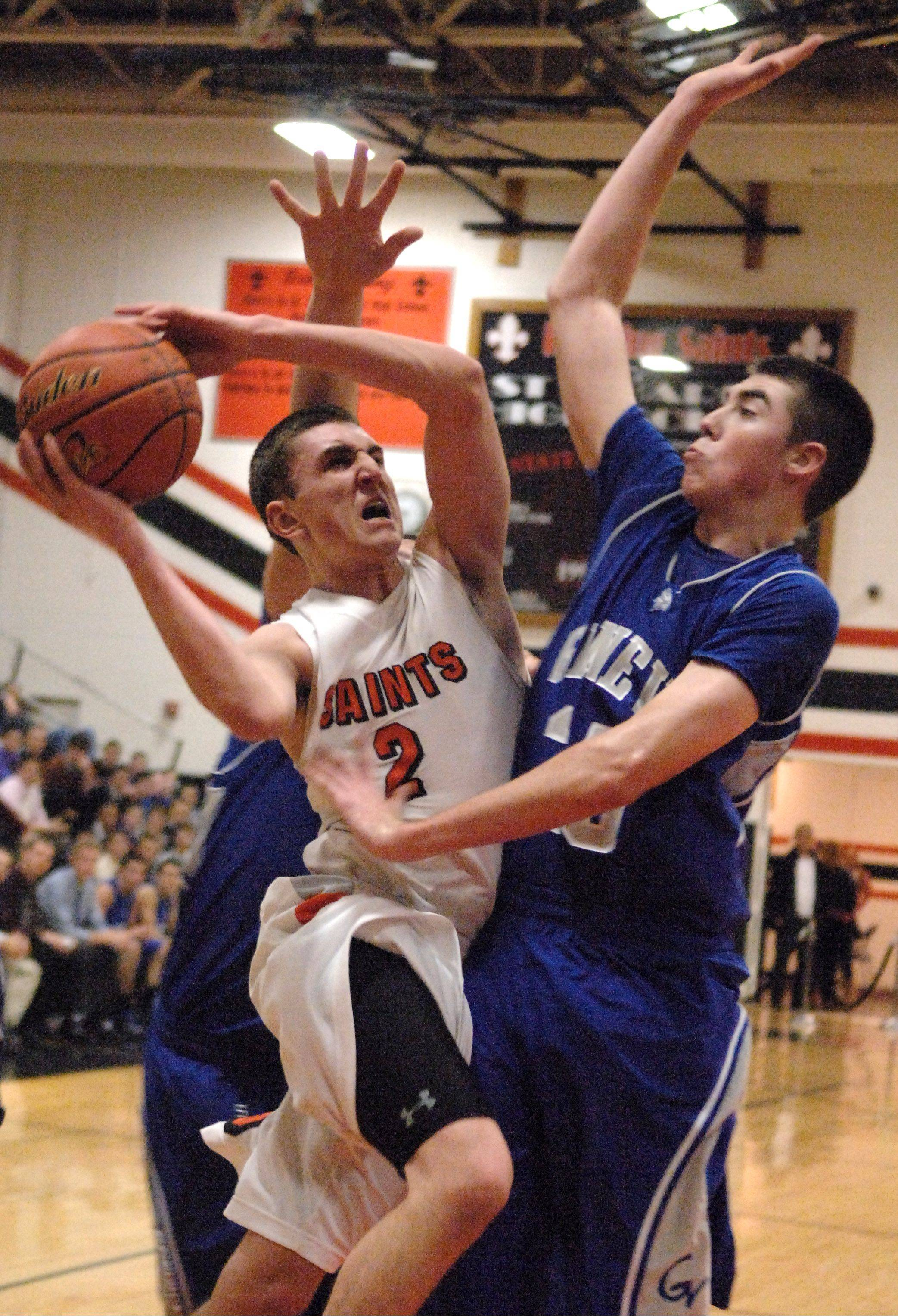 St. Charles East's Dom Adduci drives to the lane and scores despite a Geneva double-team during Friday's game in St. Charles.