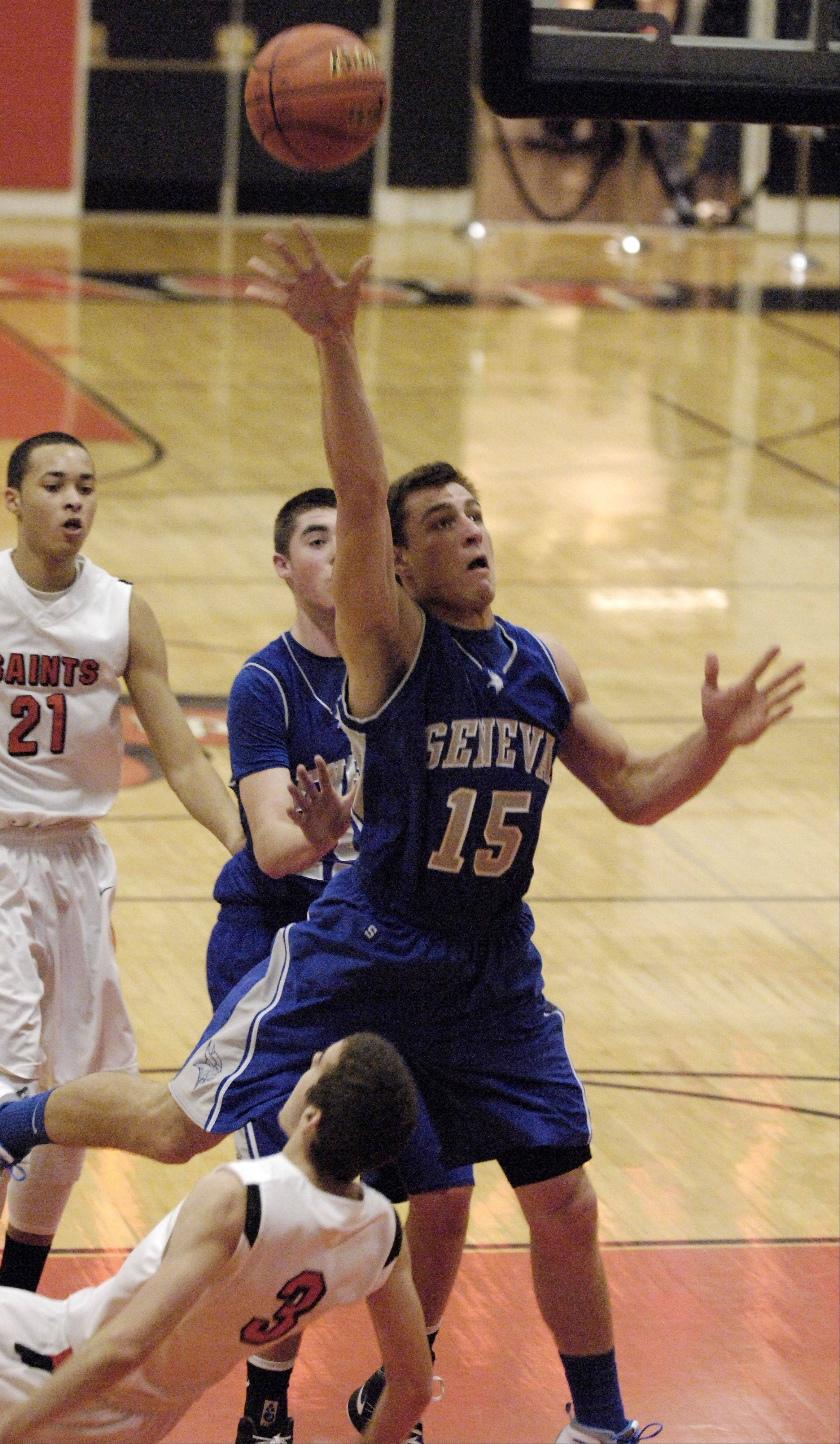 Geneva's Nate Brown puts up a shot against St. Charles East.