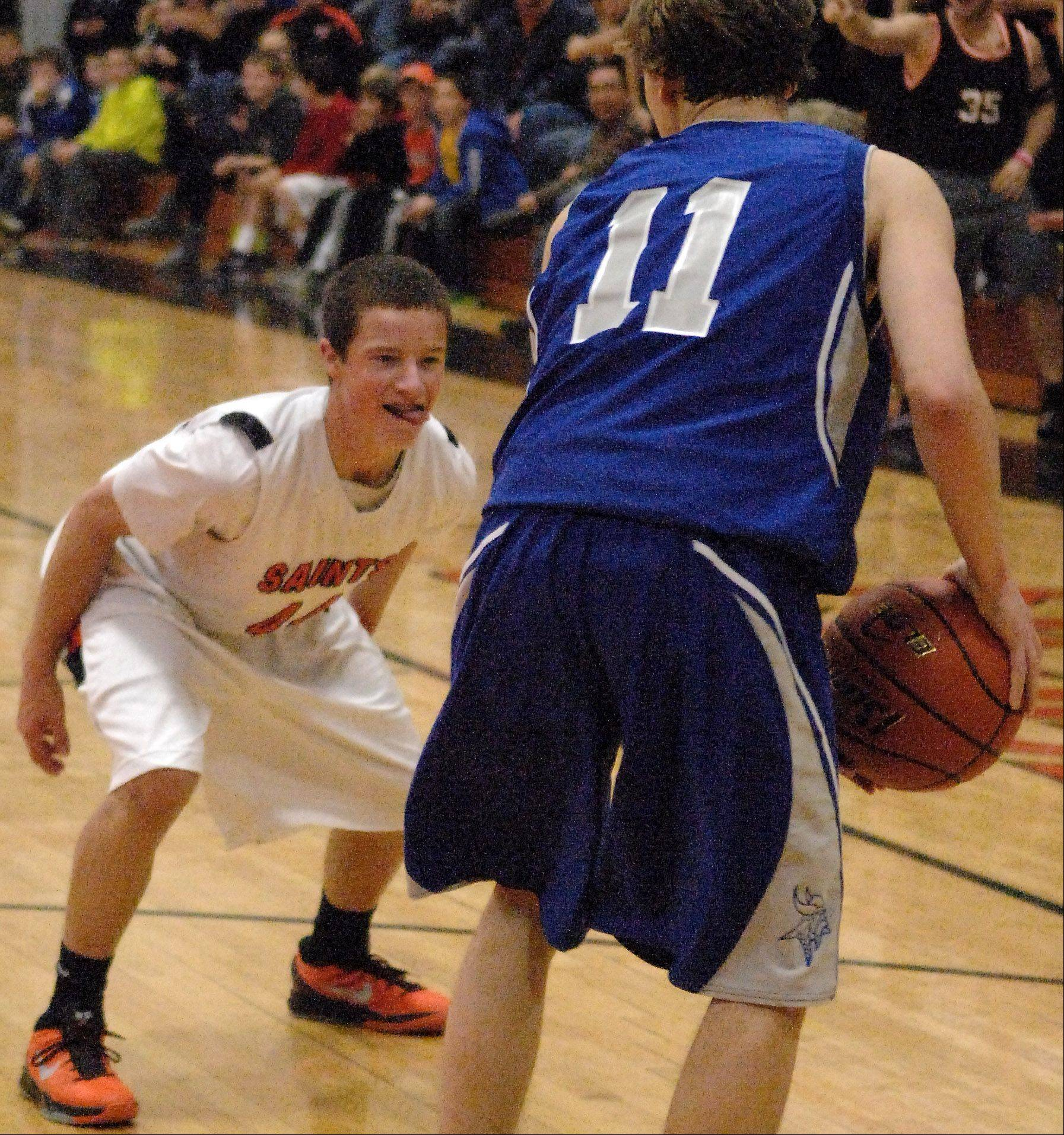 St. Charles East's Cole Gentry defends Geneva's Cam Cook.
