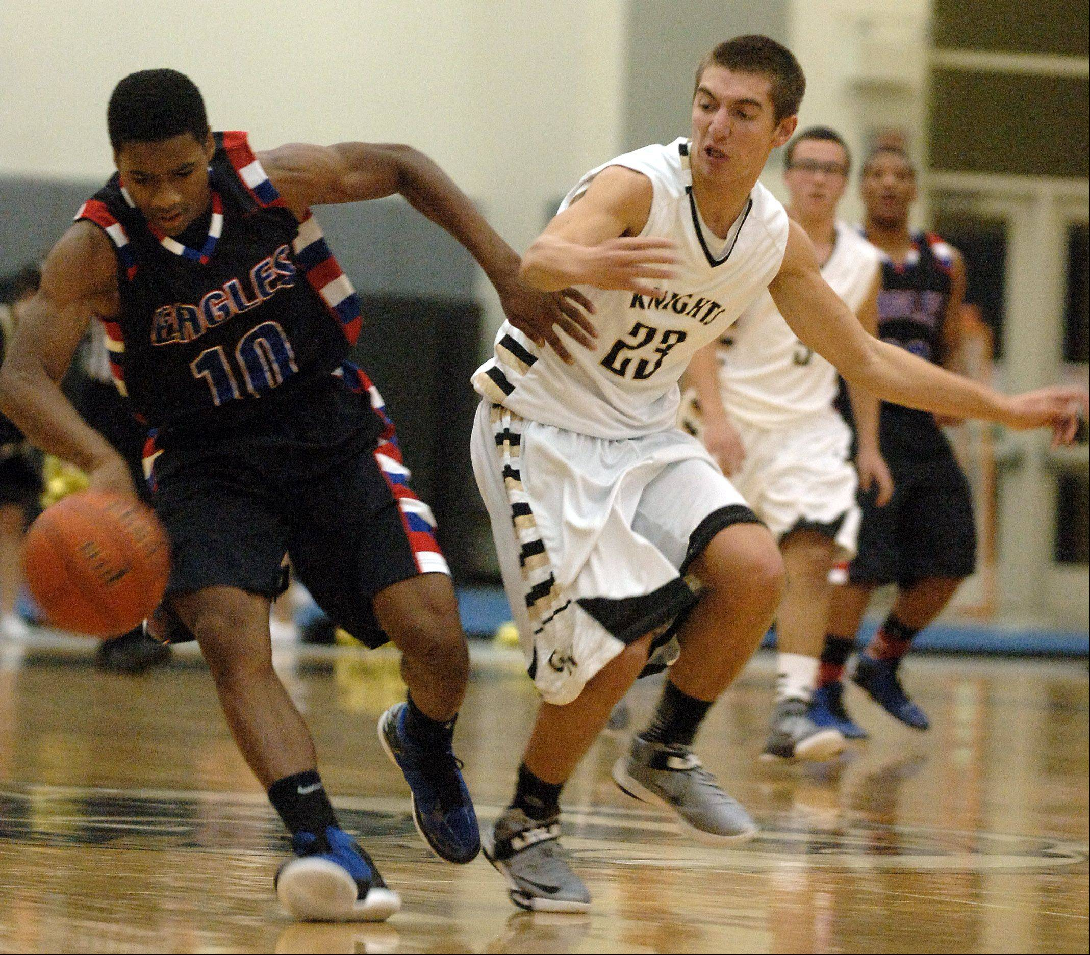 Lakes' Andrew Spencer, 10, and Grayslake North's Danny Mateling chase down a loose ball Friday in Grayslake.