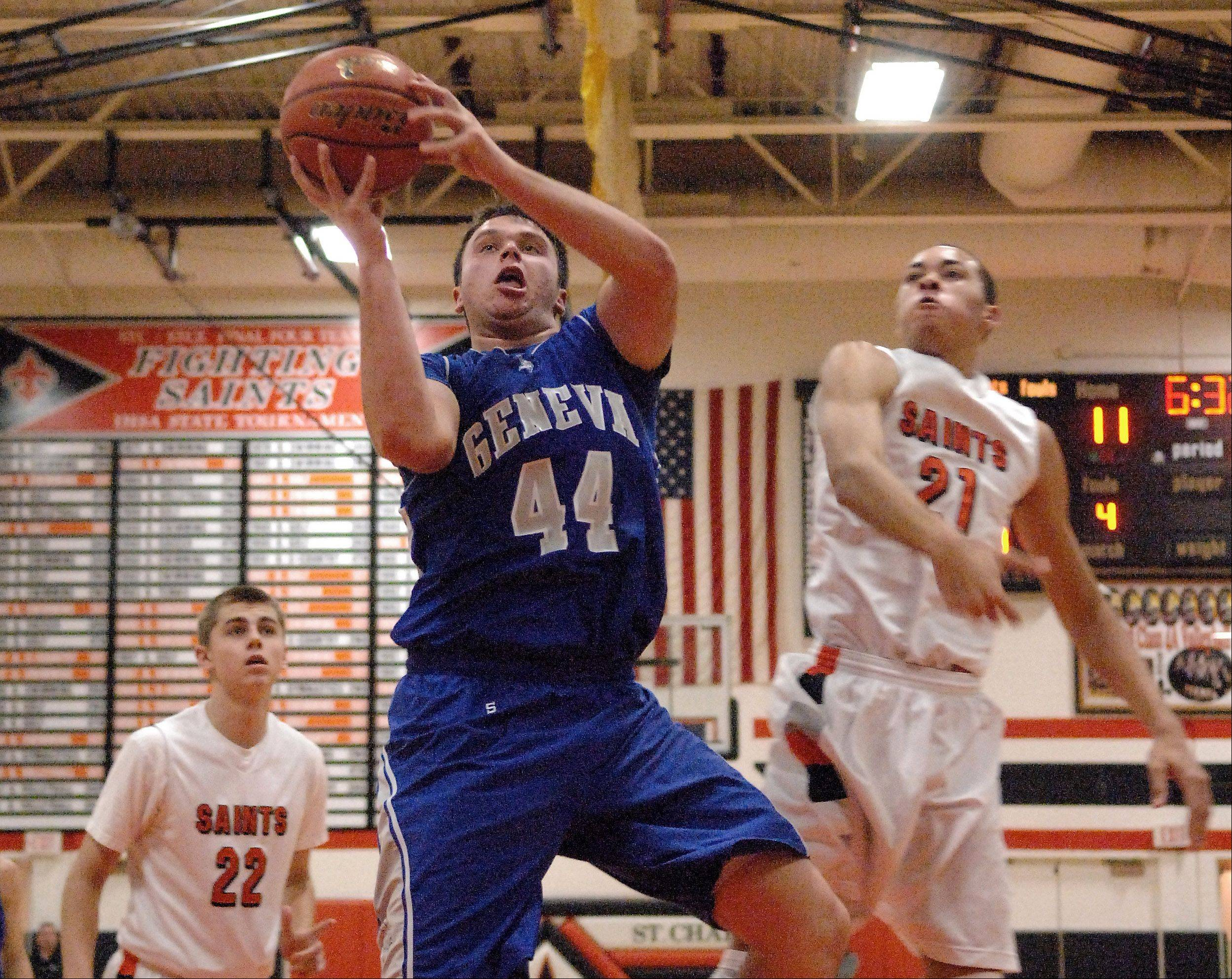 Geneva's Connor Chapman goes in for a layup against St. Charles East.
