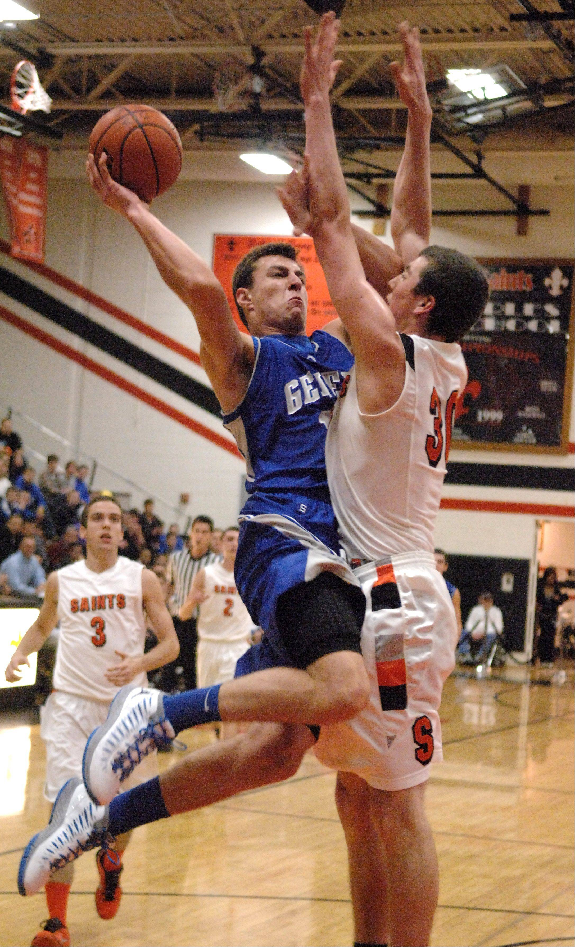 Geneva's Kyle Brown drives against St. Charles East's David Mason.