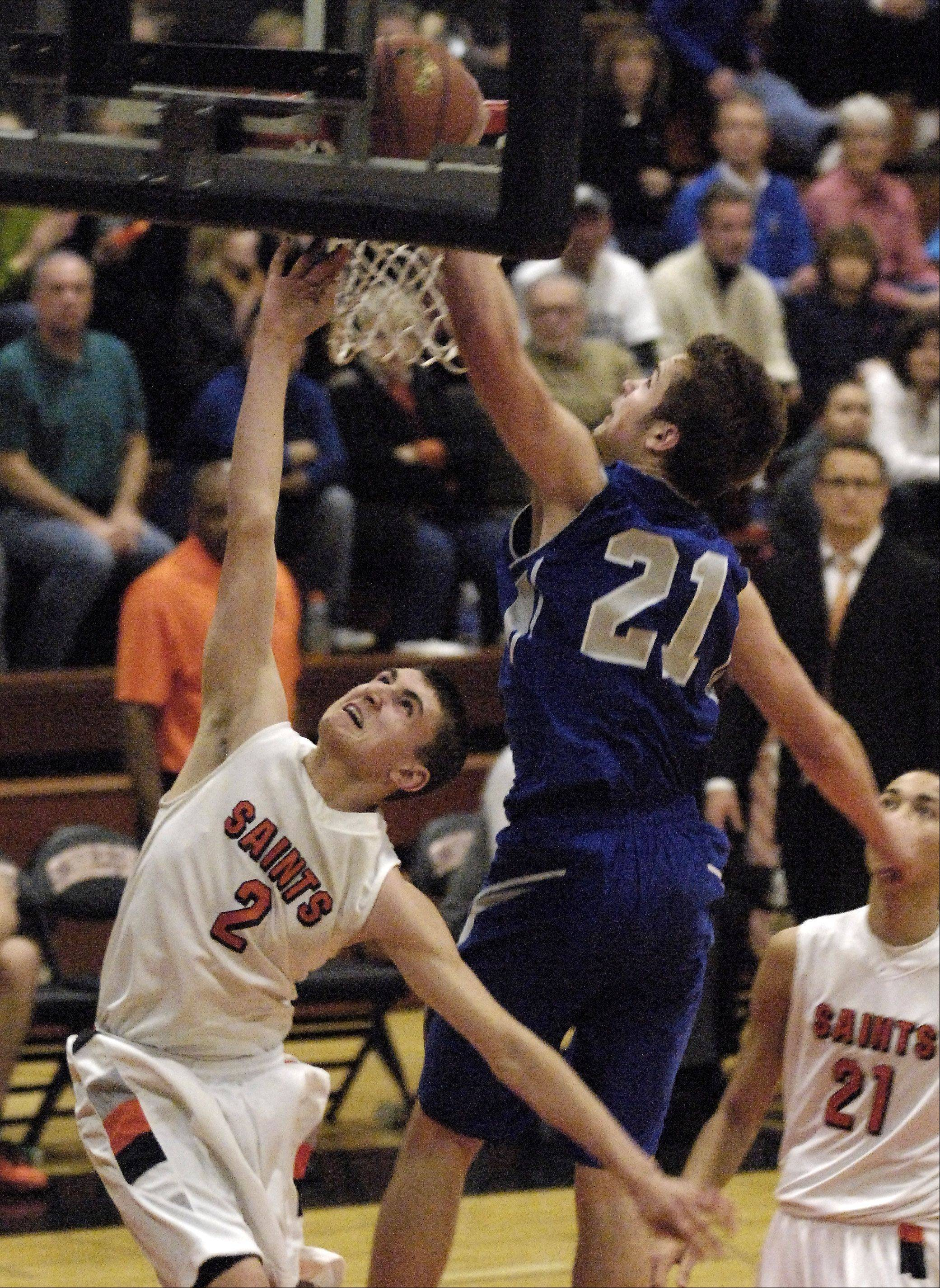 Geneva's Mike Trimble hustles back and gets a block on a breakaway by St. Charles East's Dom Adduci.