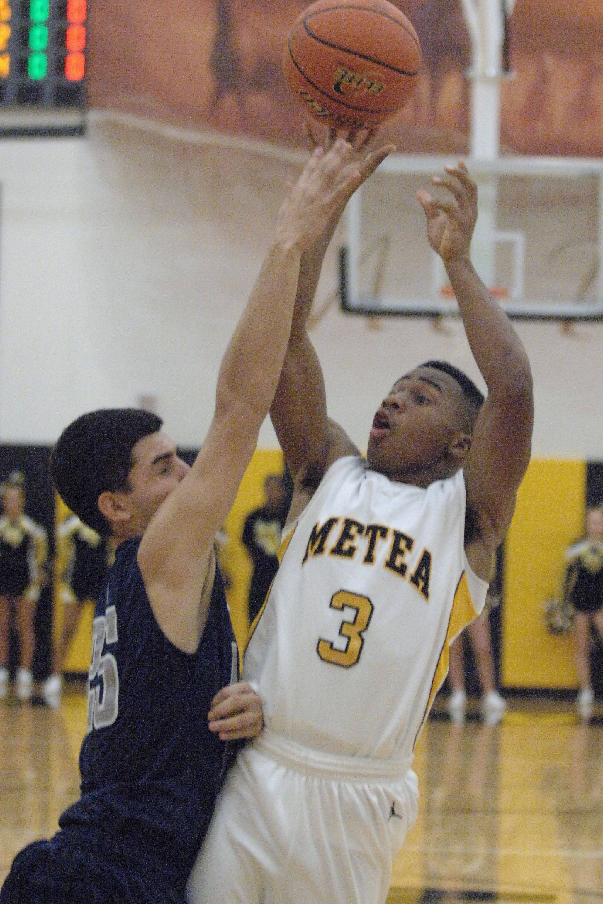 Bryson Oliver of Metea Valley takes a shot against Lake Park.