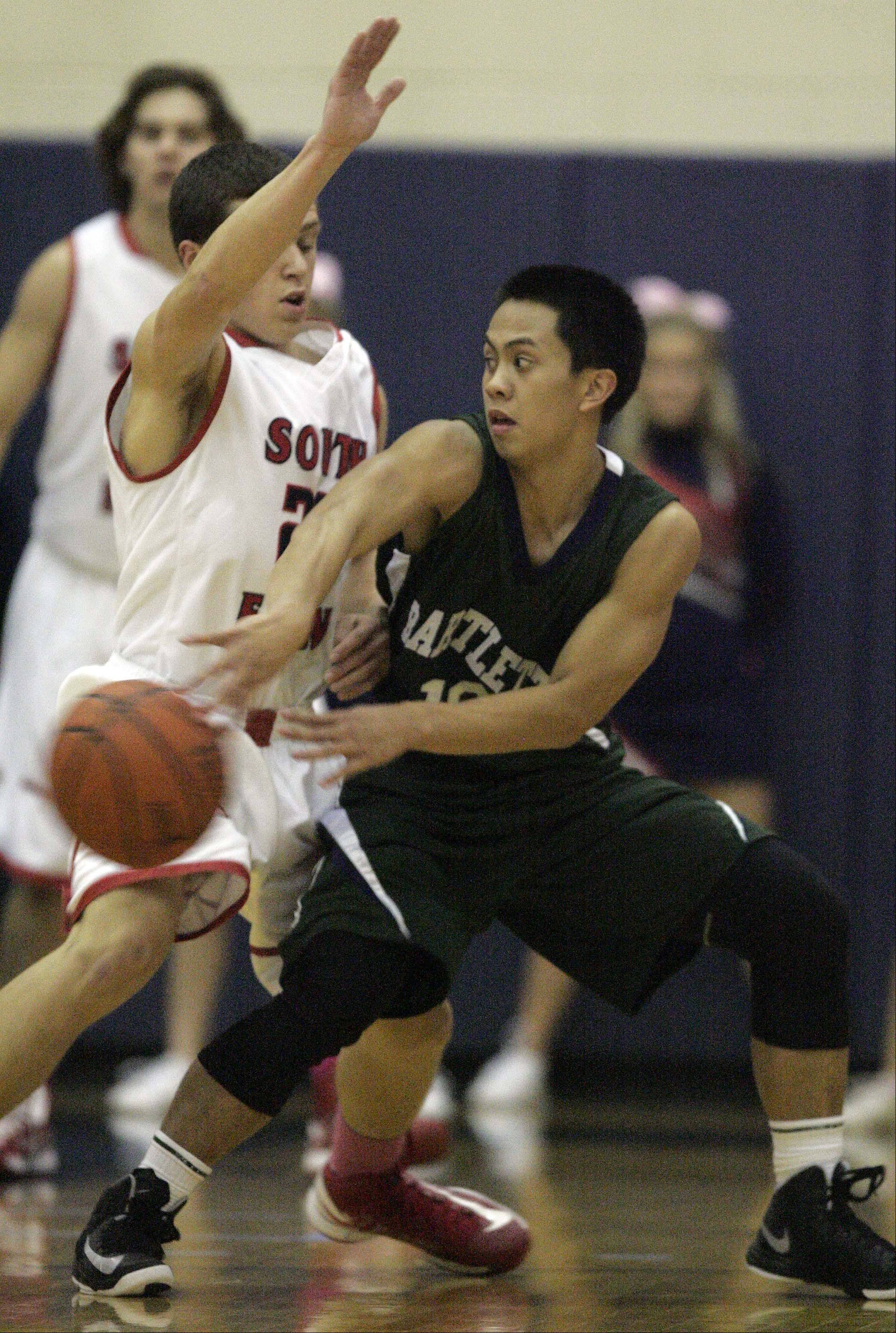 Bartlett guard Marcus Aluquin looks to pass around South Elgin guard Matt McClur.