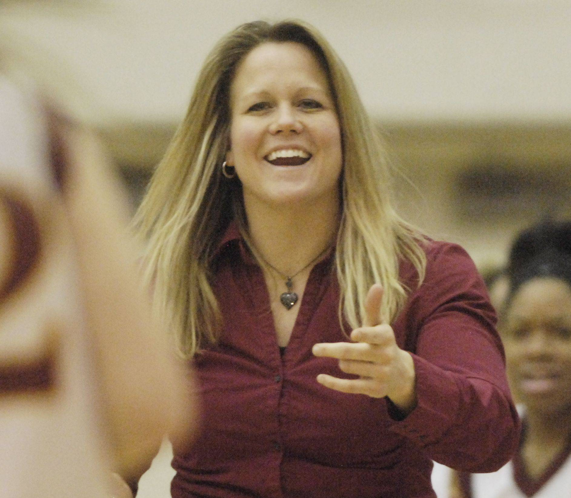 Schaumburg girls basketball coach Ashley Berggren will be inducted into the Illinois Basketball Coaches Association Hall of Fame later this season. celebrates with her team after defeating St. Charles East during Tuesday's regional semifinal at Bartlett High School.