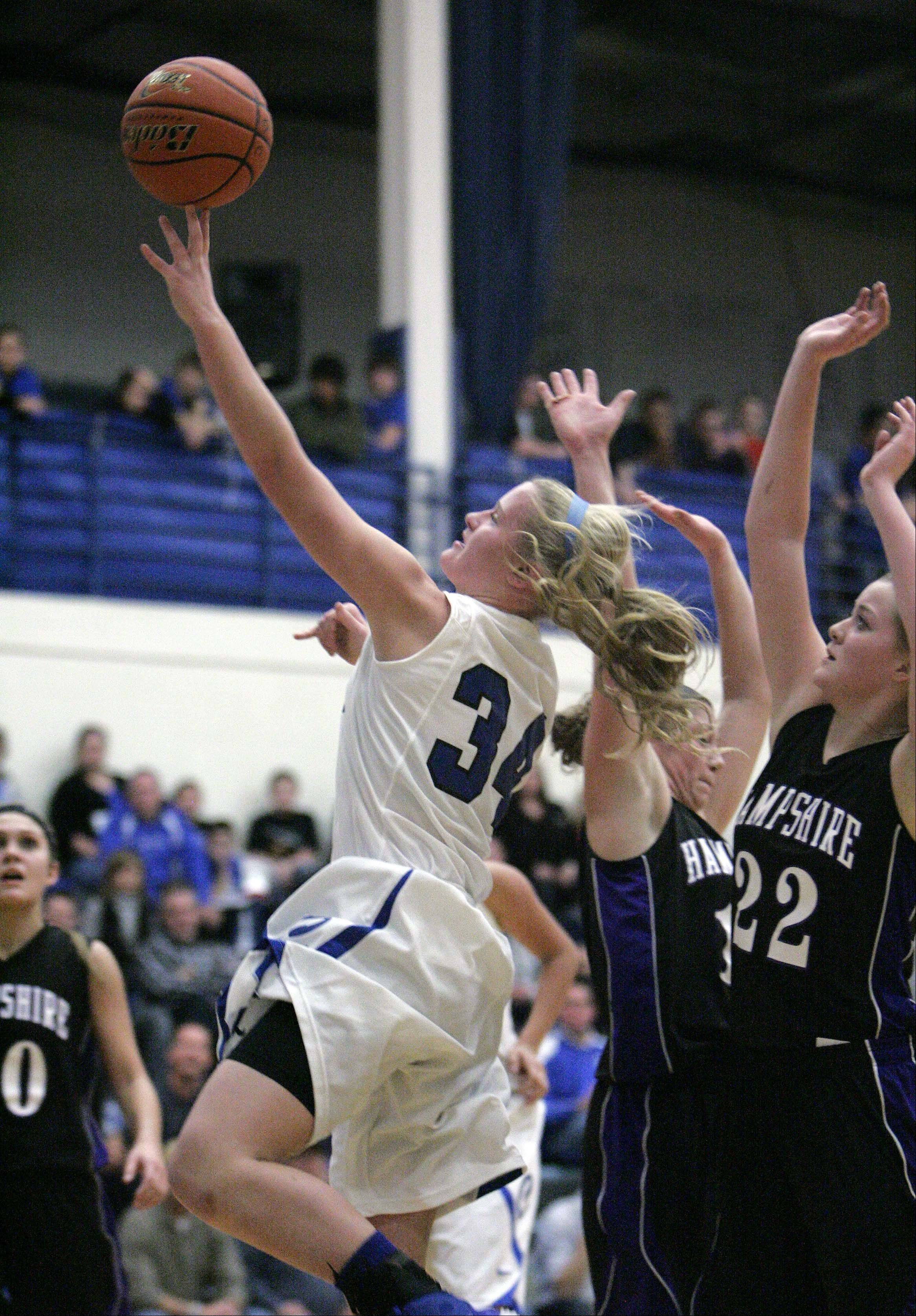 Burlington Central's Samantha Pryor (34) goes to the hoop against Hampshire Saturday.