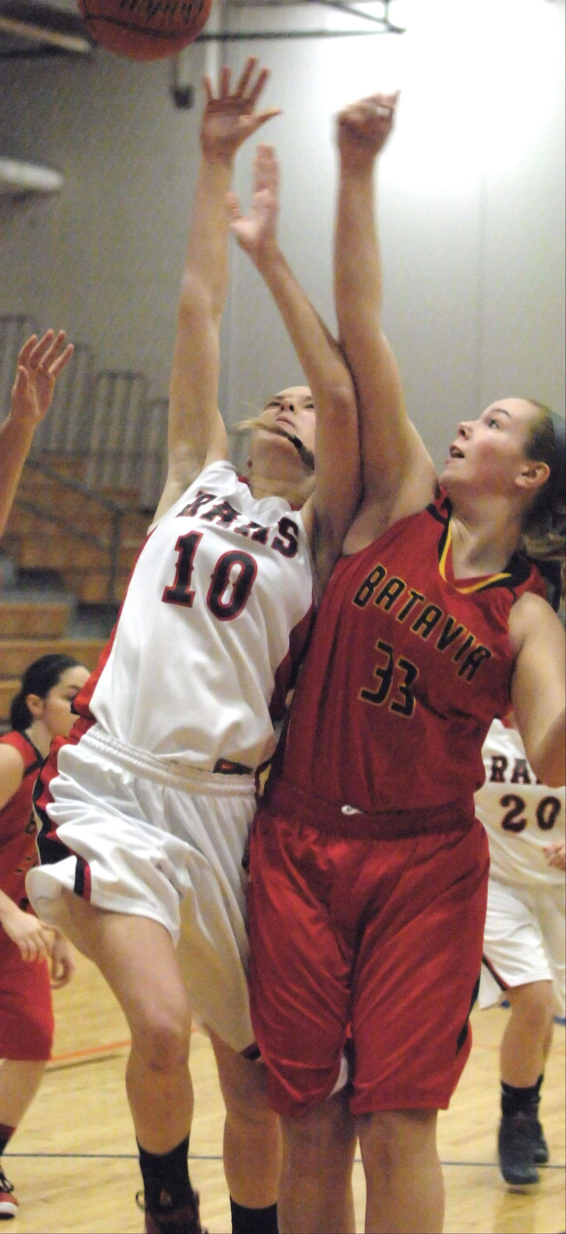 Allison Hansen of Glenbard East and Erin Bayram of Batavia go up for a rebound during the Batavia vs. Glenbard East game at the Oswego holiday tournament.