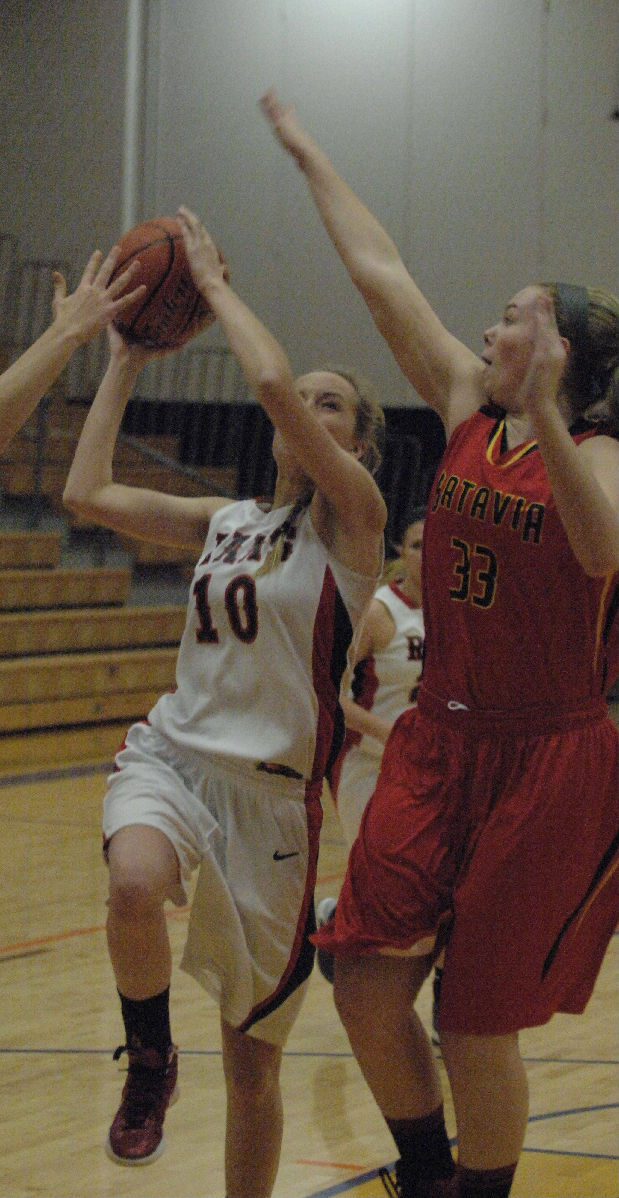 Erin Bayram defends a Glenbard East shot Saturday.
