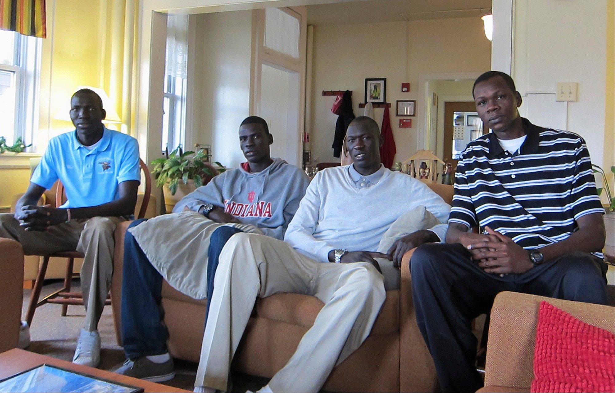 In this Friday, Dec. 7, 2012 photo, Sudanese students from left, Wal Khat, Mangisto Deng, Makur Puou and Akim Nyang pose for a photo in the living room of one of the student residences on the campus of Mooseheart Child City and School in Mooseheart, Ill., a residential center for children in Batavia. The Illinois High School Association board ruled Monday on the eligibility of the four students. While the students are allowed to complete, IHSA board placed Moosehart High School on probation.