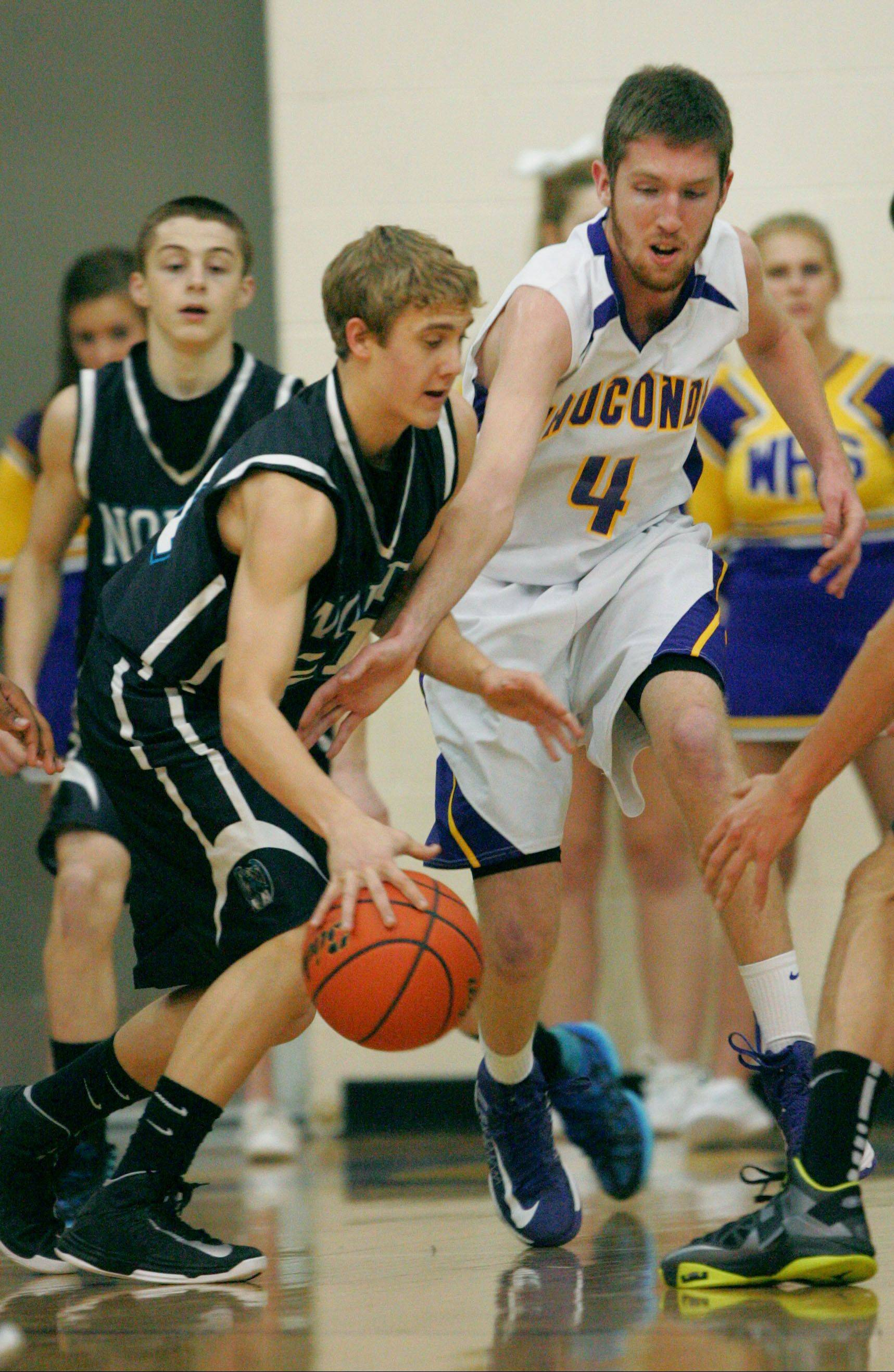 Wauconda's Ricky Sidlowski, right, tries to steal the ball from Woodstock North's Shane Zieman on Monday at Wauconda.