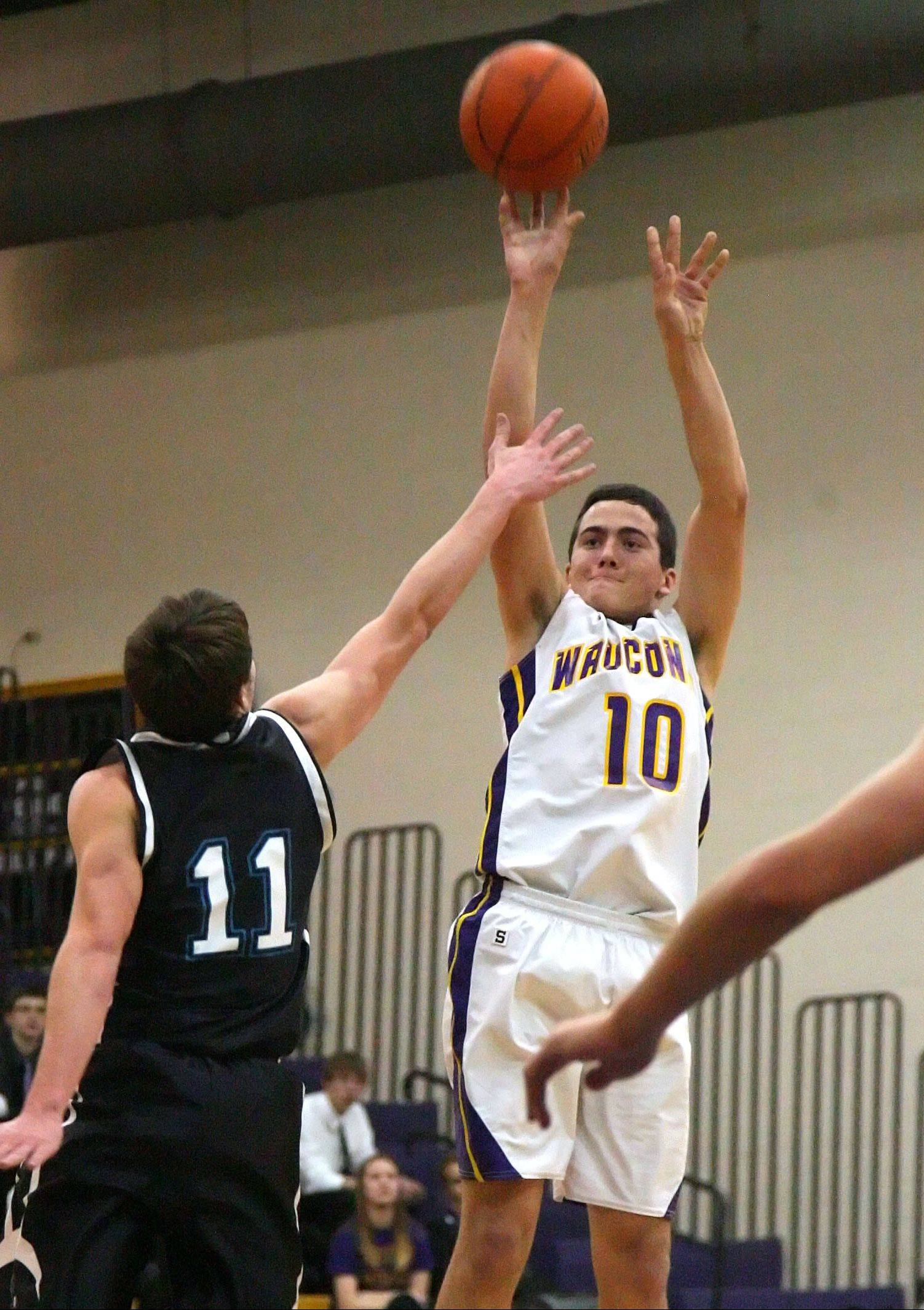 Wauconda's Austin Swenson, right, shoots over Woodstock North's Keith Blomberg on Monday night at Wauconda.