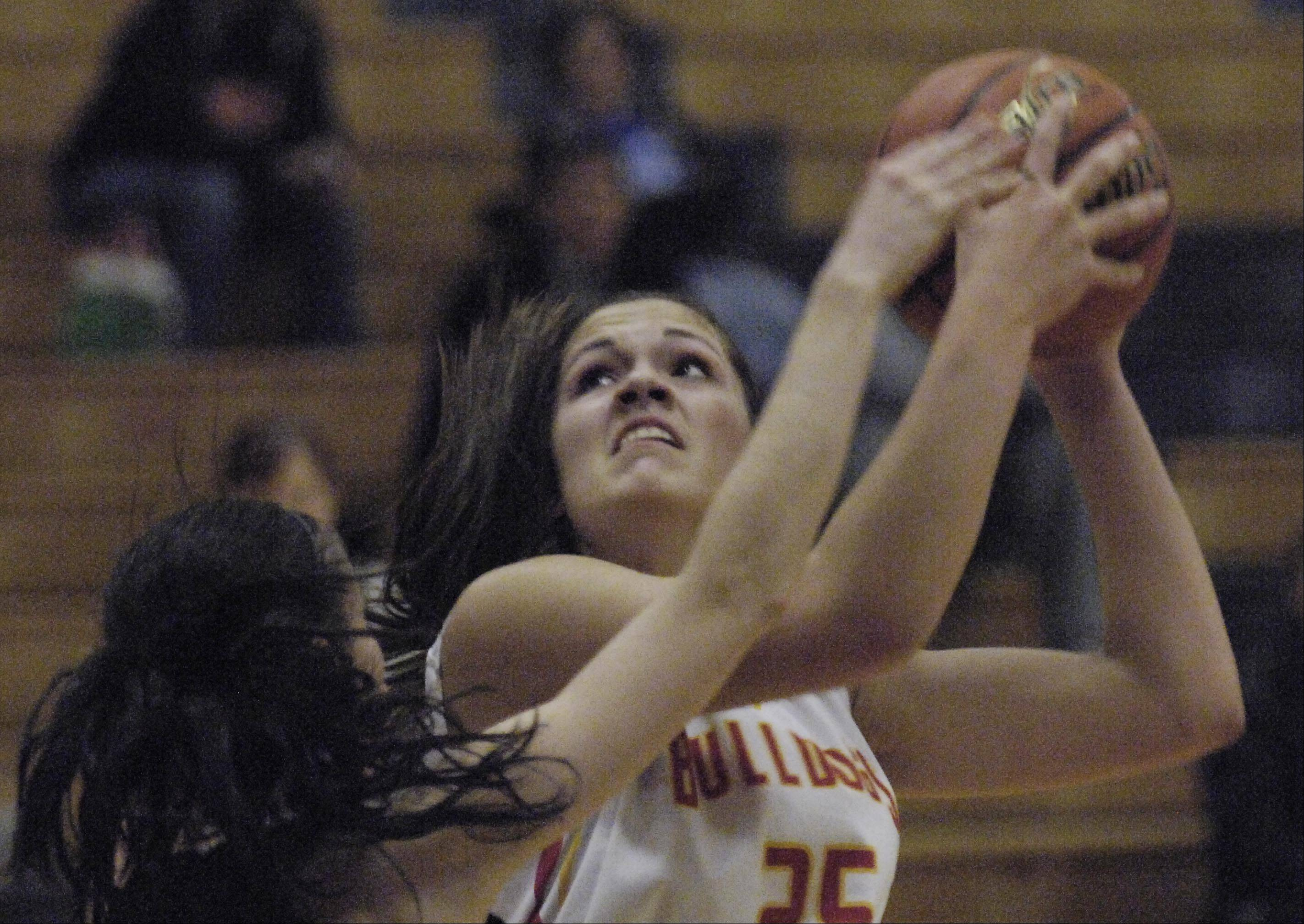 Batavia's Hannah Frazier shoots over Minooka's Alexa Hinkleman at the Oswego High School Holiday Classic Monday.