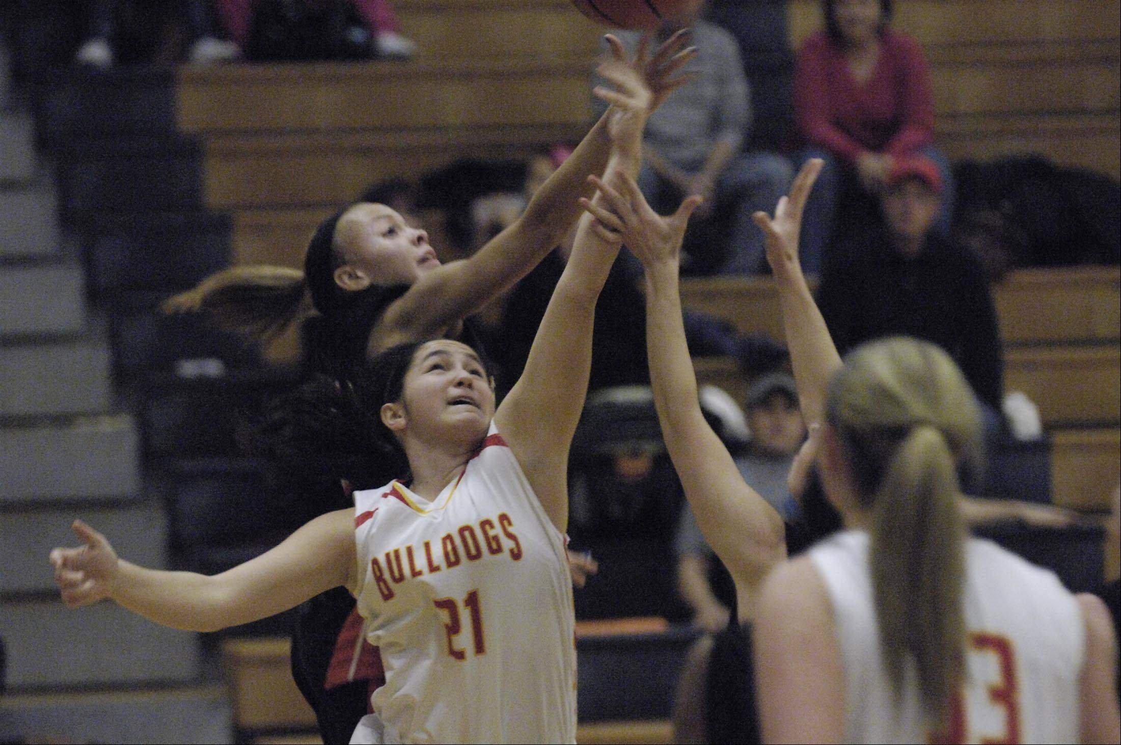 John Starks/jstarks@dailyherald.com Batavia's Sami Villarreal fights for a rebound against Minooka at the Oswego High School Holiday Classic Monday.