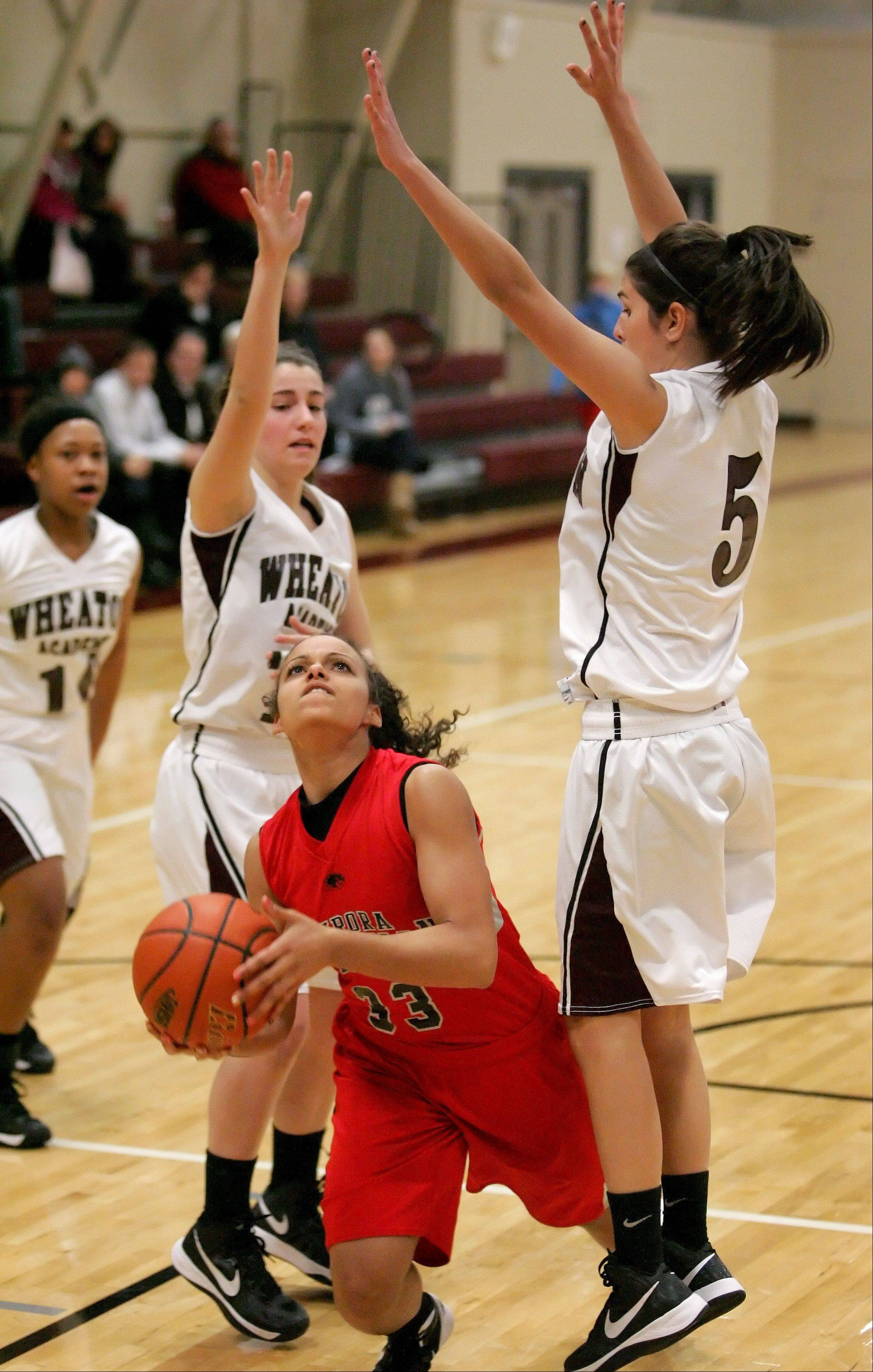 Alyssa Andersen of Aurora Christian moves through Wheaton Academy defenders.
