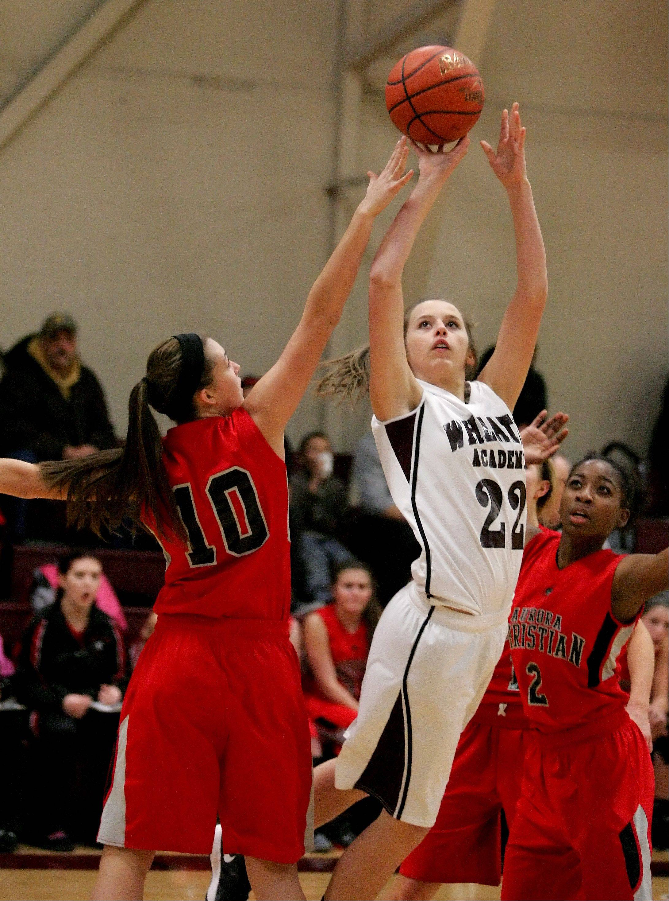 Elizabeth Melby of Wheaton Academy attempts a two-point basket as Melissa Moser, left, of Aurora Christian defends.