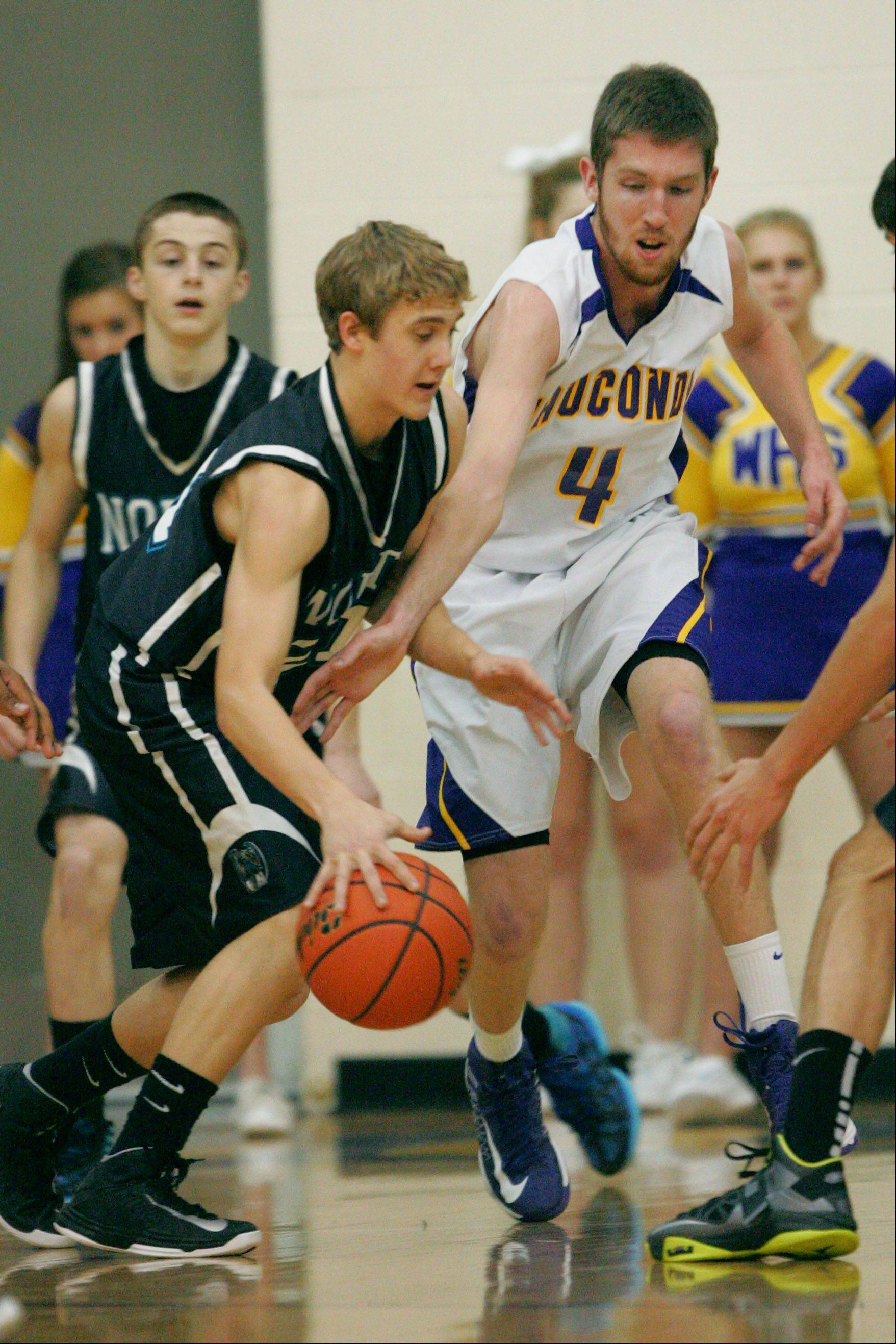 Wauconda's Ricky Sidlowski, right, tries to steal the ball from Woodstock North's Shane Zieman.