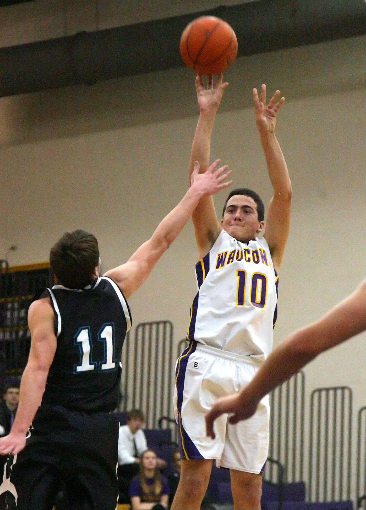 Wauconda's Austin Swenson, right, shoots over Woodstock North's Keith Blomberg.