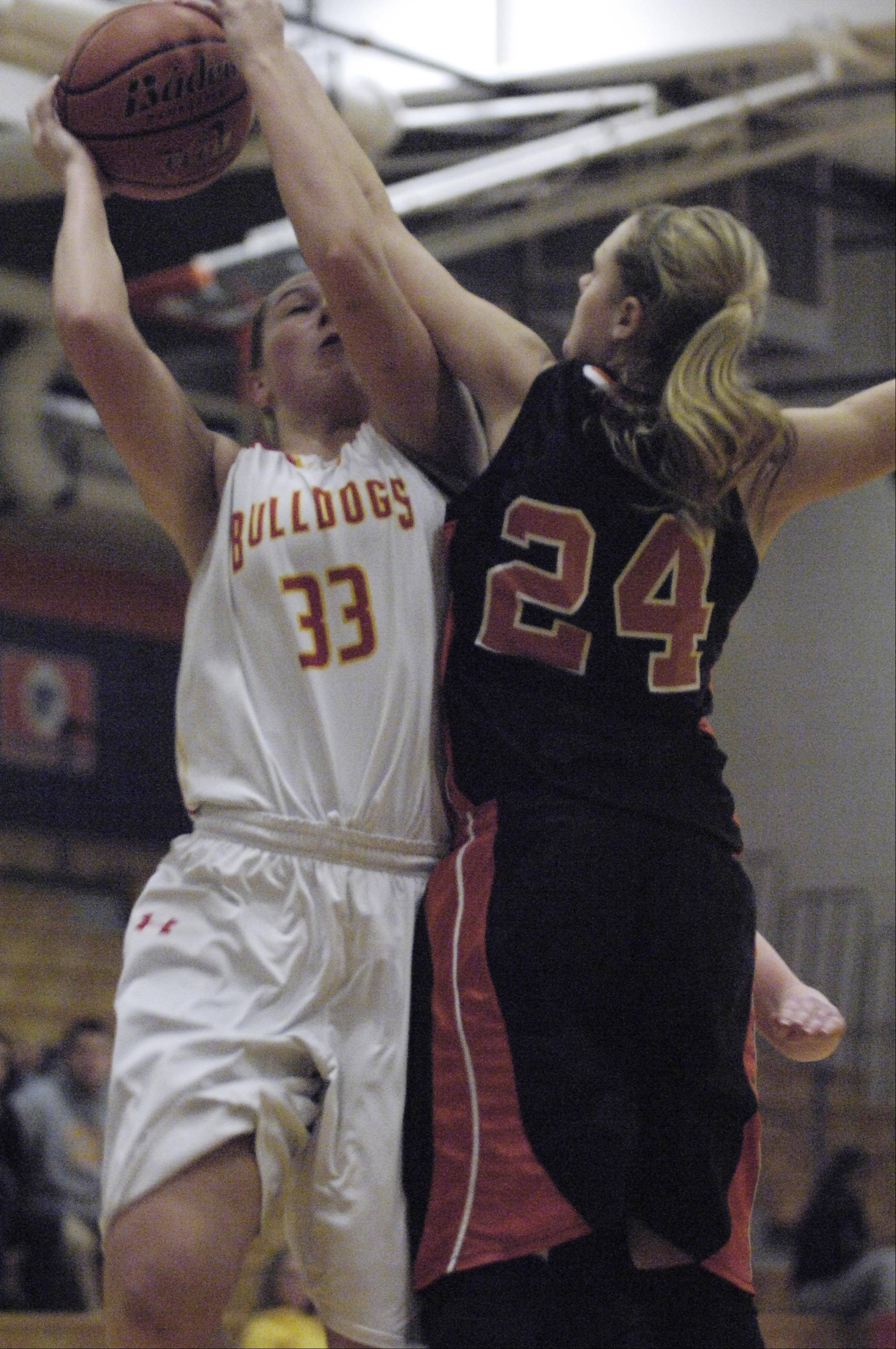 Batavia's Erin Bayram is fouled by Minooka's Larissa McLemen.
