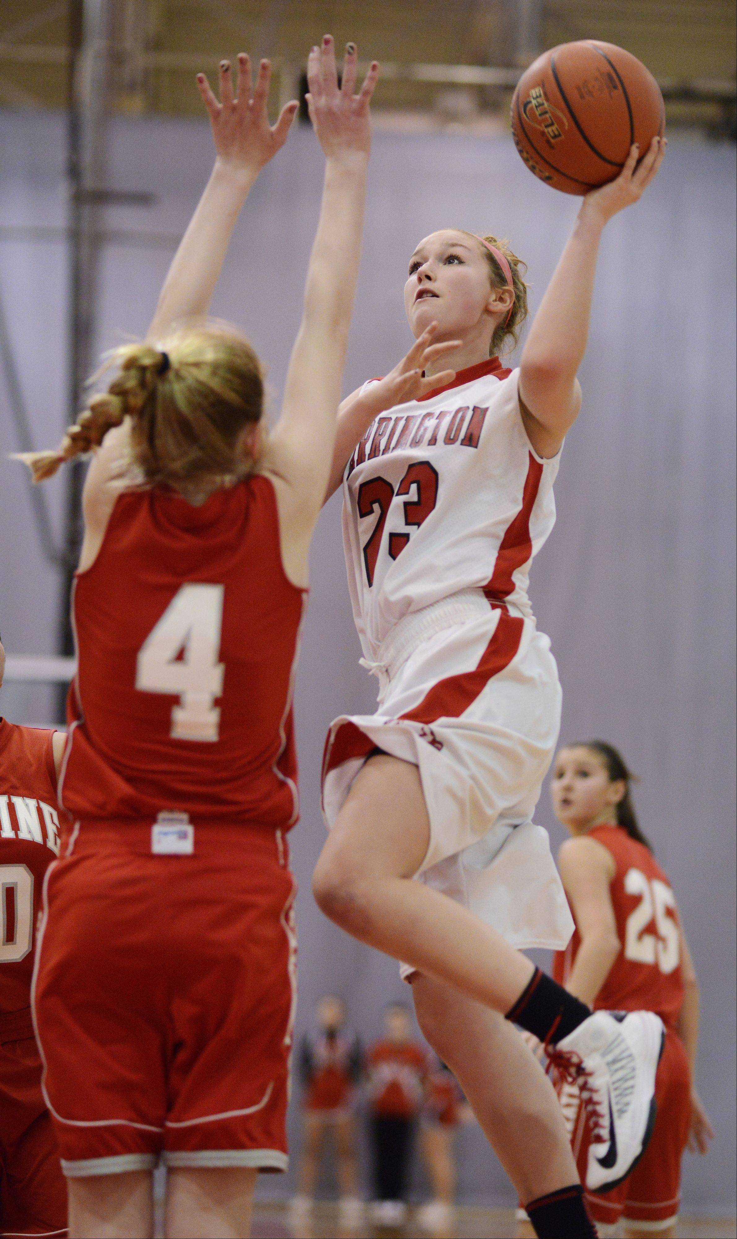 Barrington's Brooke Gunderson takes a shot as Palatine's Morgan Radtke defends during Tuesday's game at Barrington.