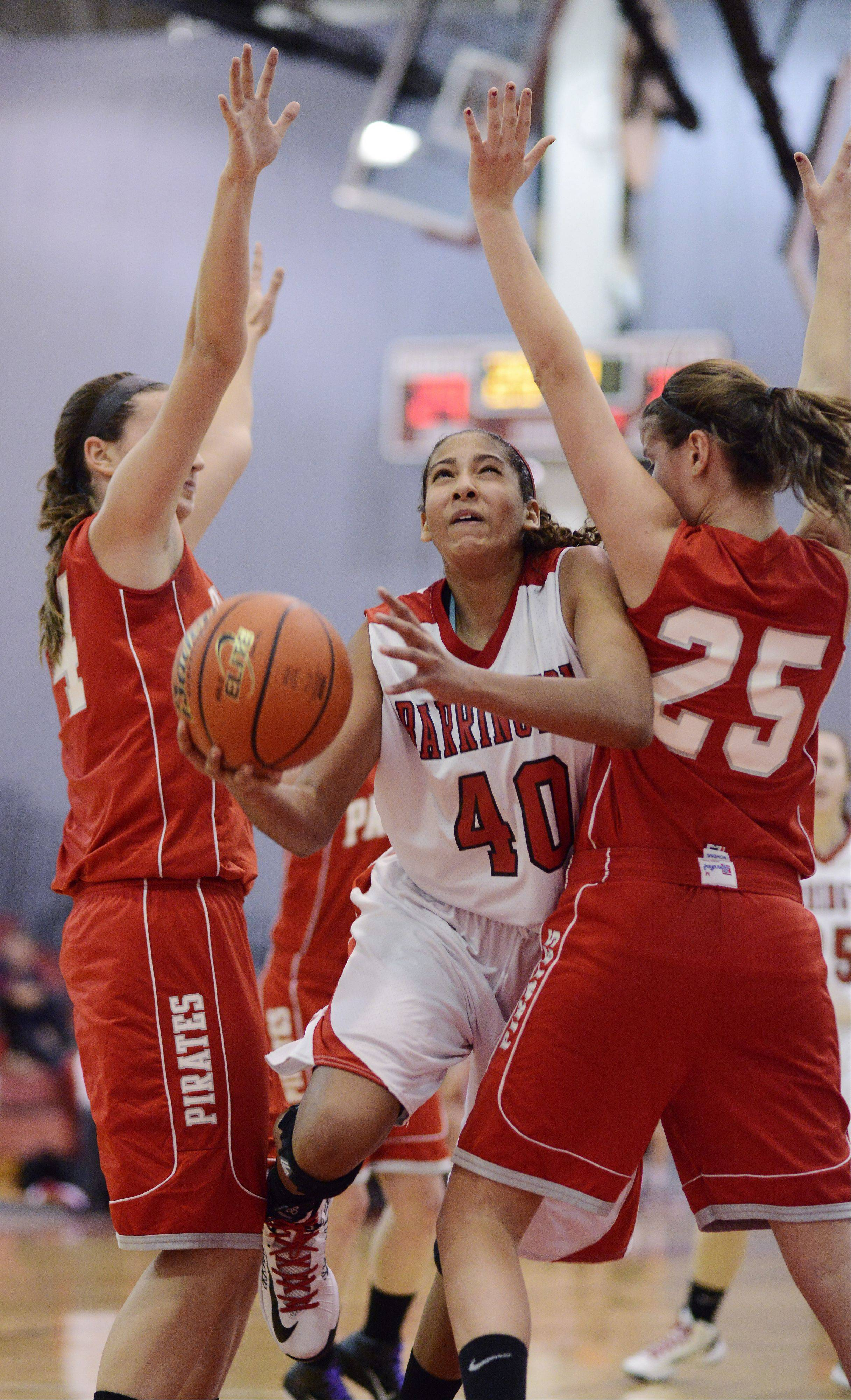 Barrington's Bryanna Hopkins, middle, tries to squeeze between Palatine's Monica Masini, left, and Erin Mayer during Tuesday's game.