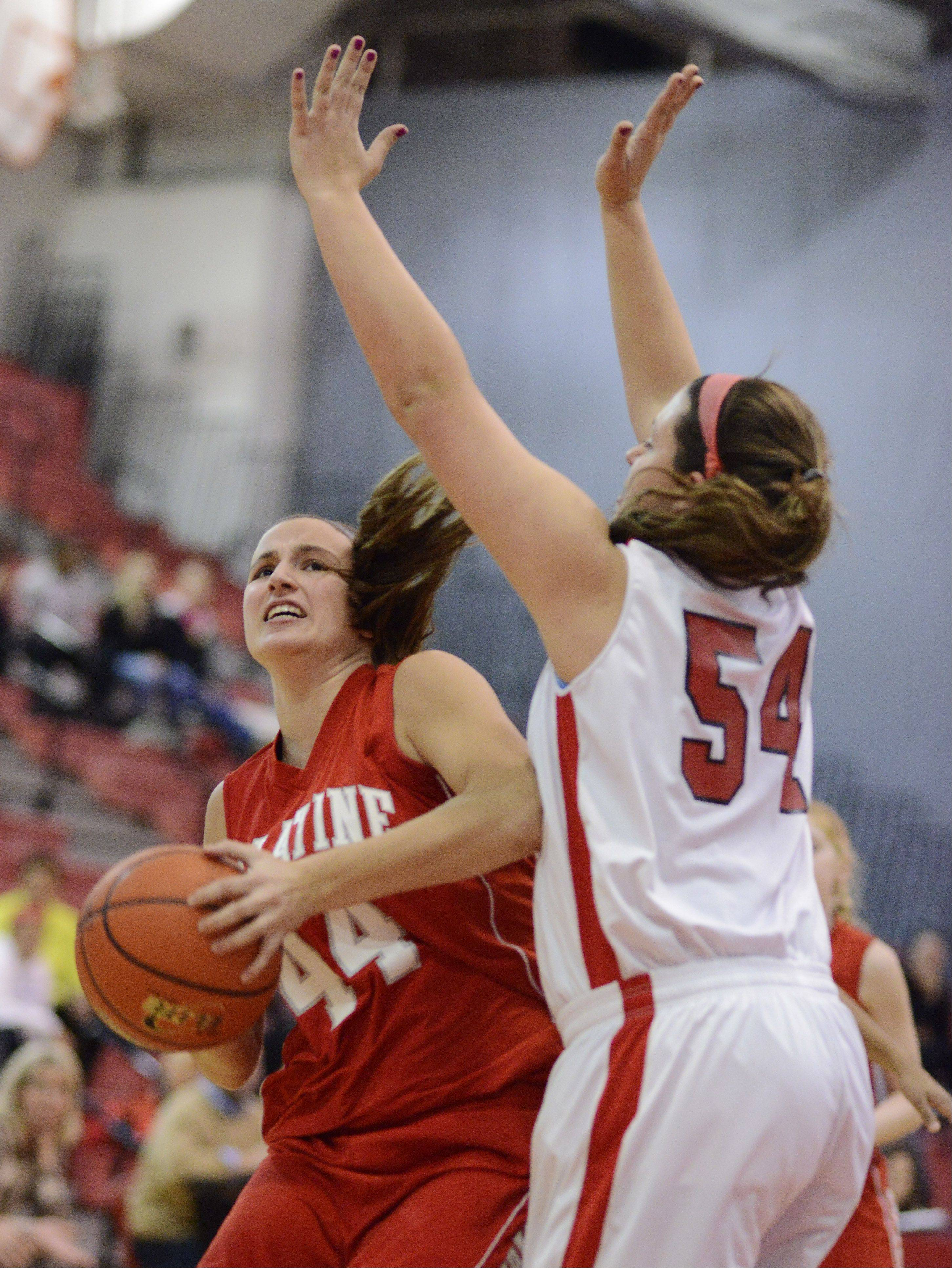 Palatine's Monica Masini makes a move near the basket against the defense of Barrington's Alexa Resch during Tuesday's game.