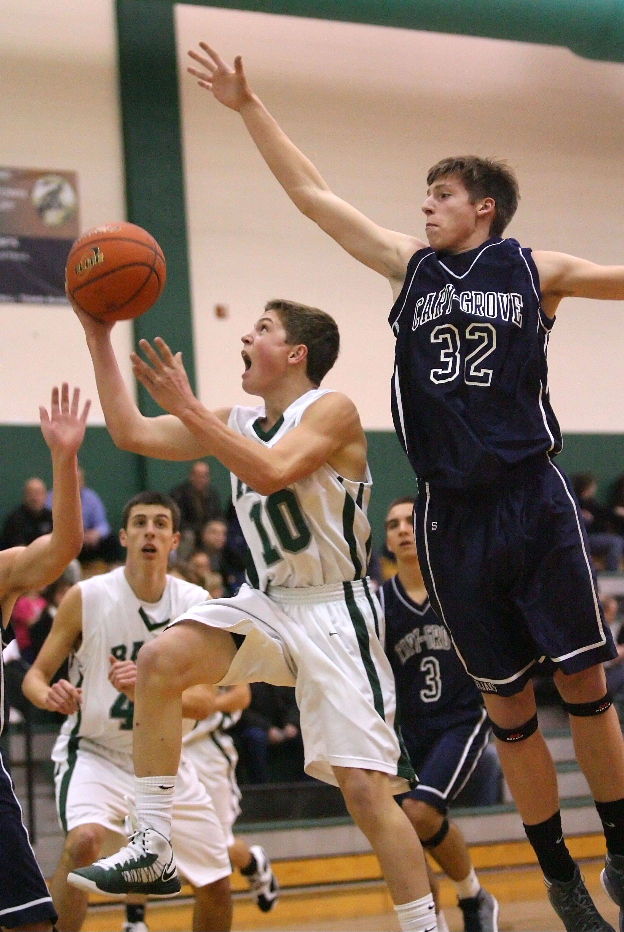 Grayslake Central's Joey Mudd, left, drives on Cary-Grove's Dean Lee on Tuesday night at Grayslake Central.