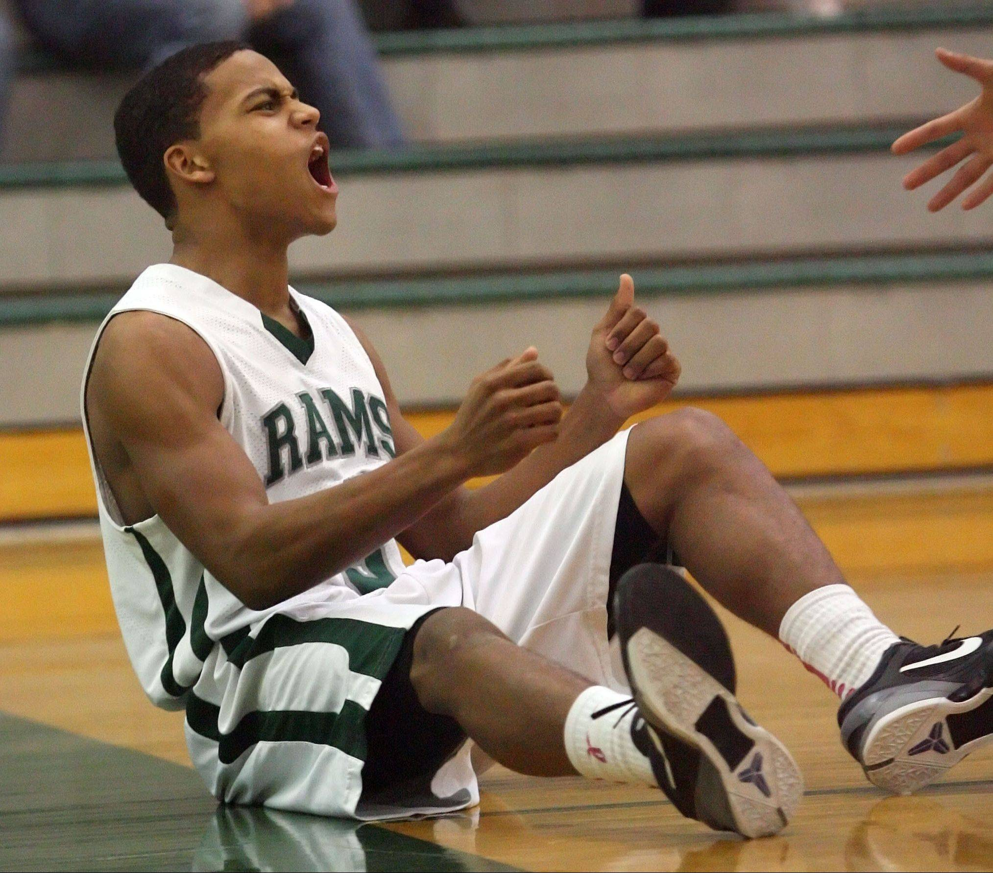 Grayslake Central's Malcolm Reed cheers after getting fouled by Cary-Grove on Tuesday night at Grayslake Central.