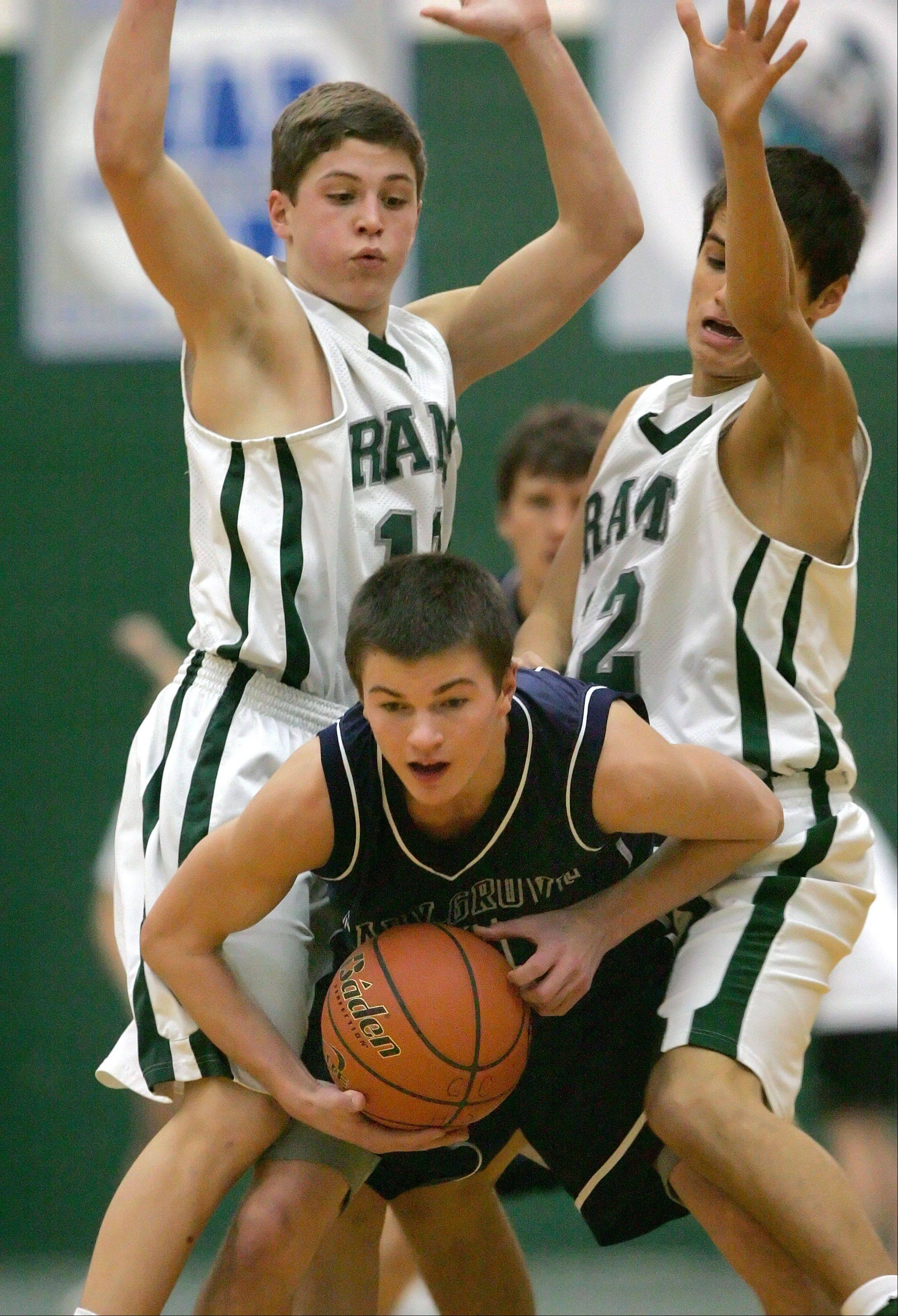 Grayslake Central's Joey Mudd, left, and Kevin Orozco double team Cary-Grove's Ian May on Tuesday night at Grayslake Central.