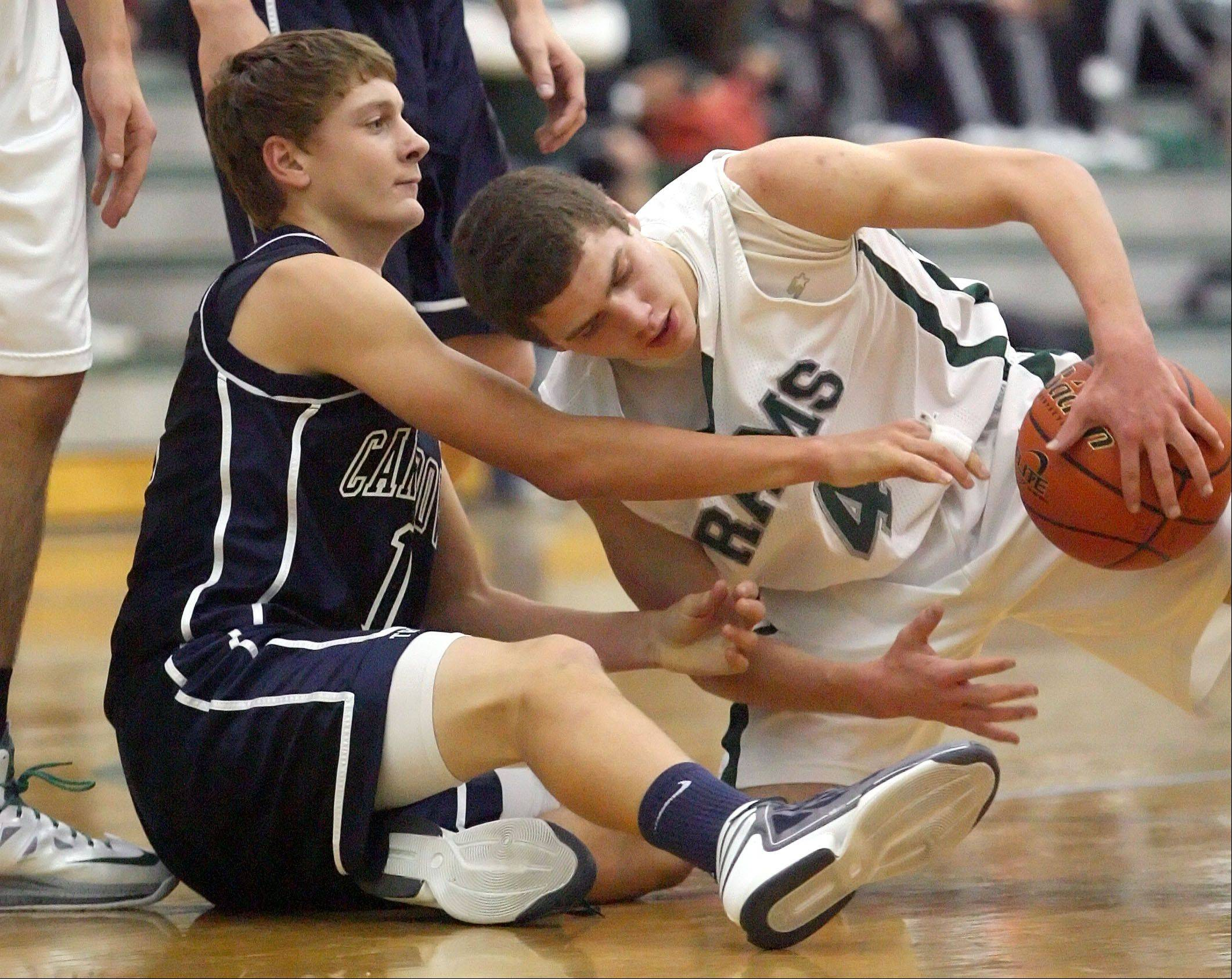 Cary-Grove's Jason Gregoire, left, and Grayslake Central's Jacob Vargo during action Tuesday night at Grayslake Central.