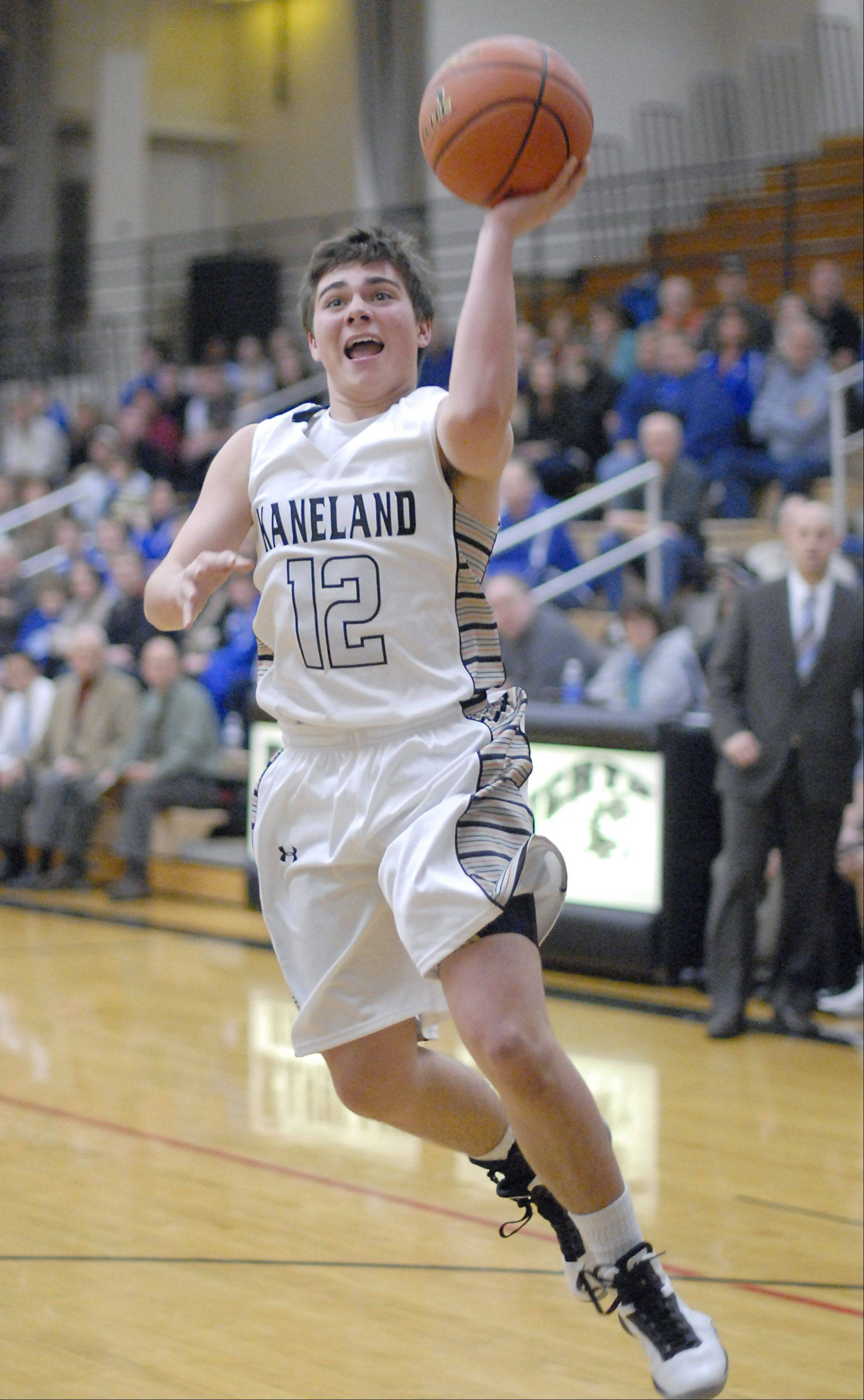 Kaneland's Connor Fedderly sinks a shot in the third quarter vs. Hinckley-Big Rock on Tuesday, December 11.