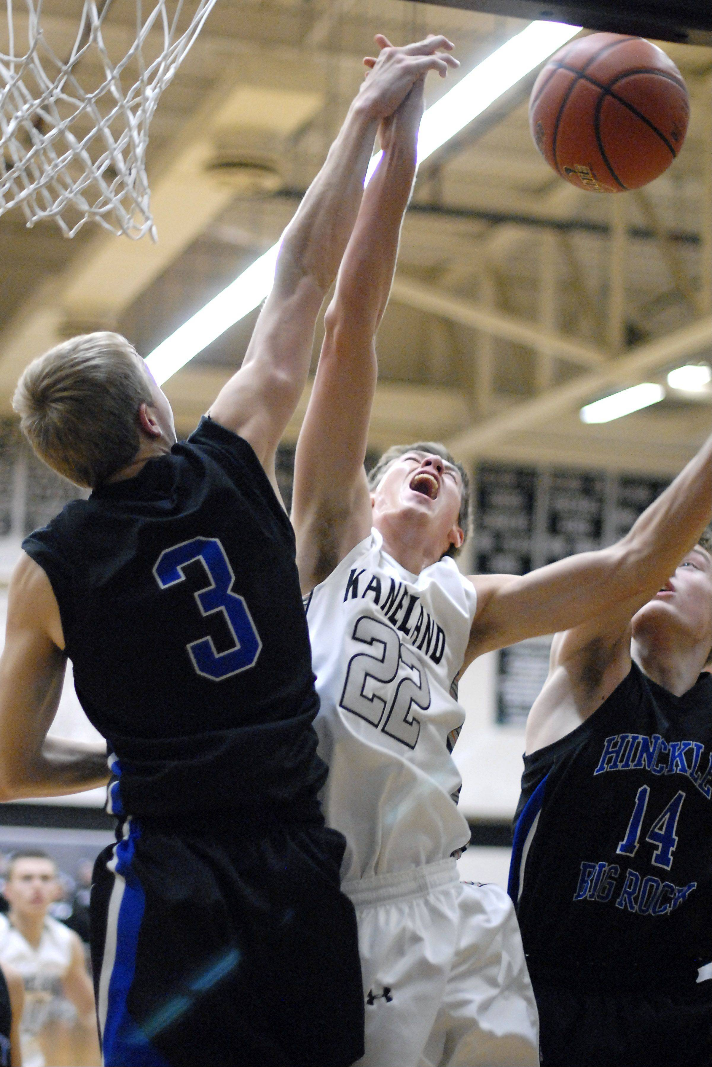 Kaneland's Dan Miller is denied a shot by Hinckley-Big Rock's Jared Madden in the second quarter on Tuesday, December 11.