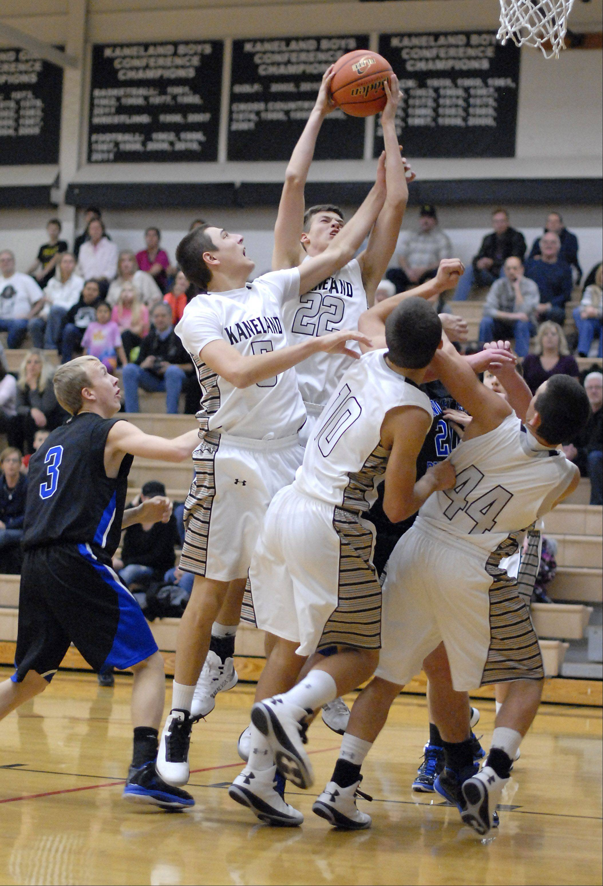 Kaneland's Dan Miller reaches up and grabs a Knights rebound in the first quarter vs. Hinckley-Big Rock on Tuesday, December 11.